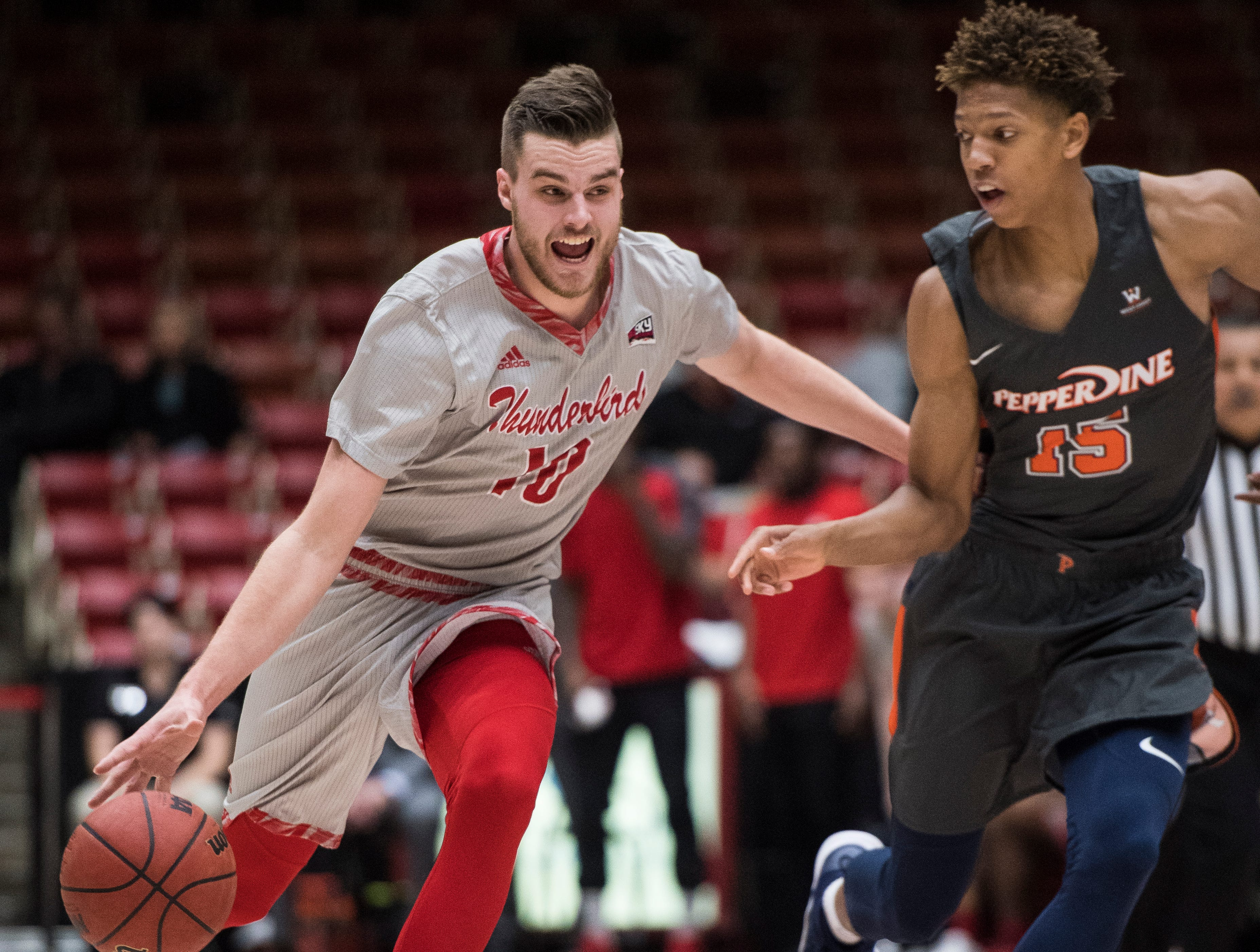 Southern Utah University junior Jacob Calloway (10) runs down the court against Pepperdine University in the America First Event Center Saturday, December 15, 2018. SUU won in overtime, 78-69.