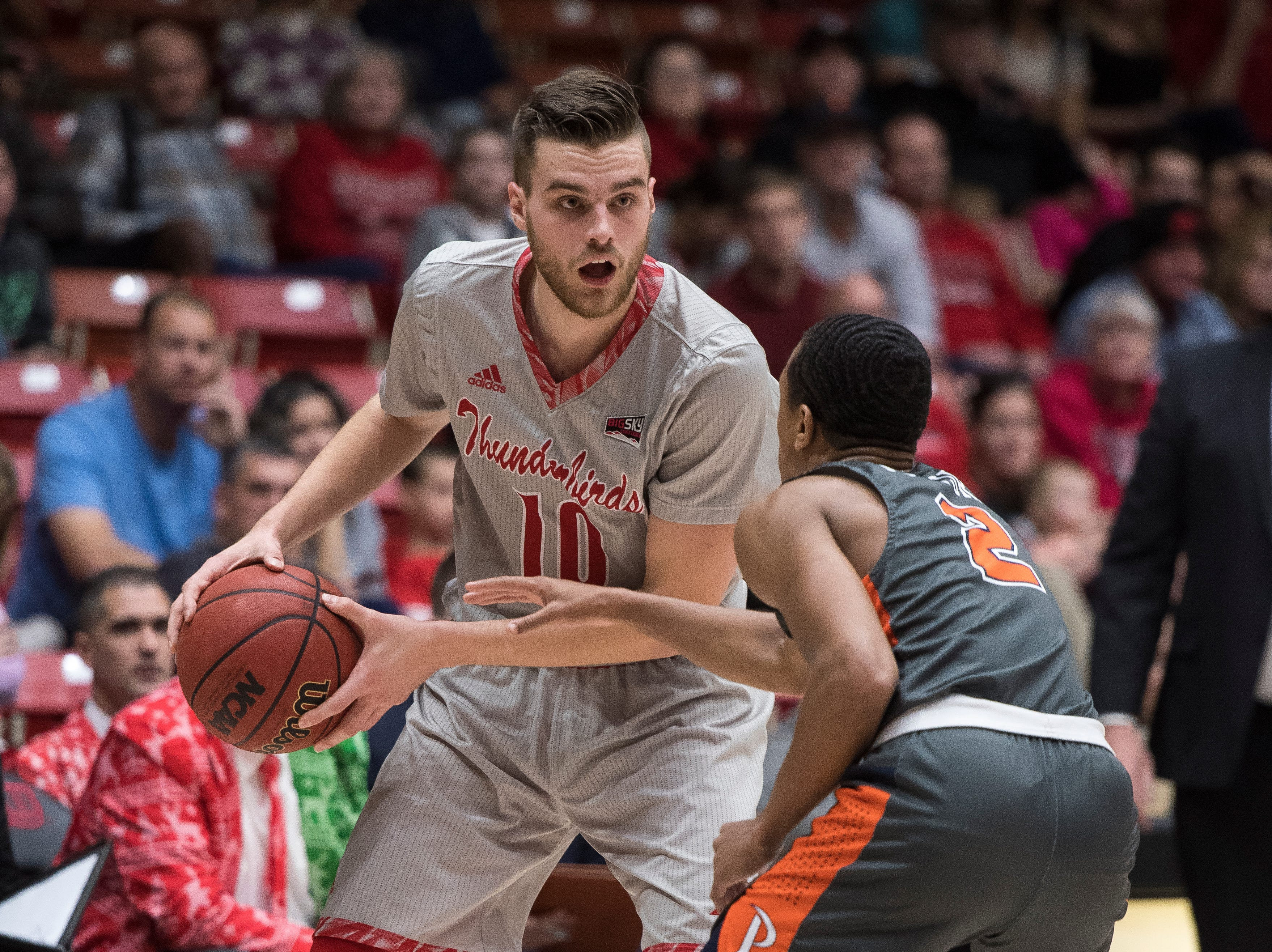 Southern Utah University junior Jacob Calloway (10) looks over the head of a Pepperdine defender in the America First Event Center Saturday, December 15, 2018. SUU won in overtime, 78-69.
