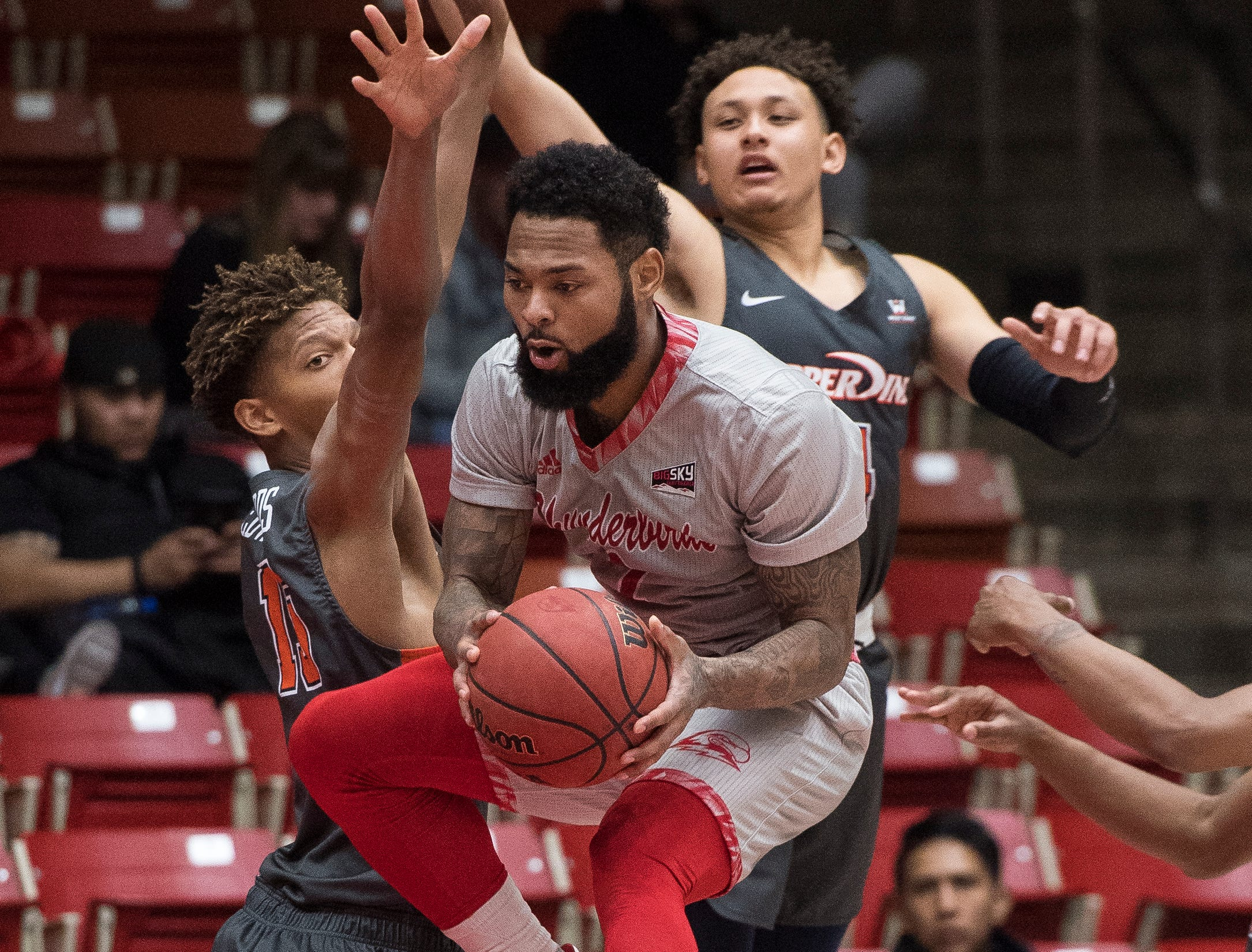 Southern Utah University freshman Kenton Eskridge (1) leaps through the air against Pepperdine University in the America First Event Center Saturday, December 15, 2018. SUU won in overtime, 78-69.