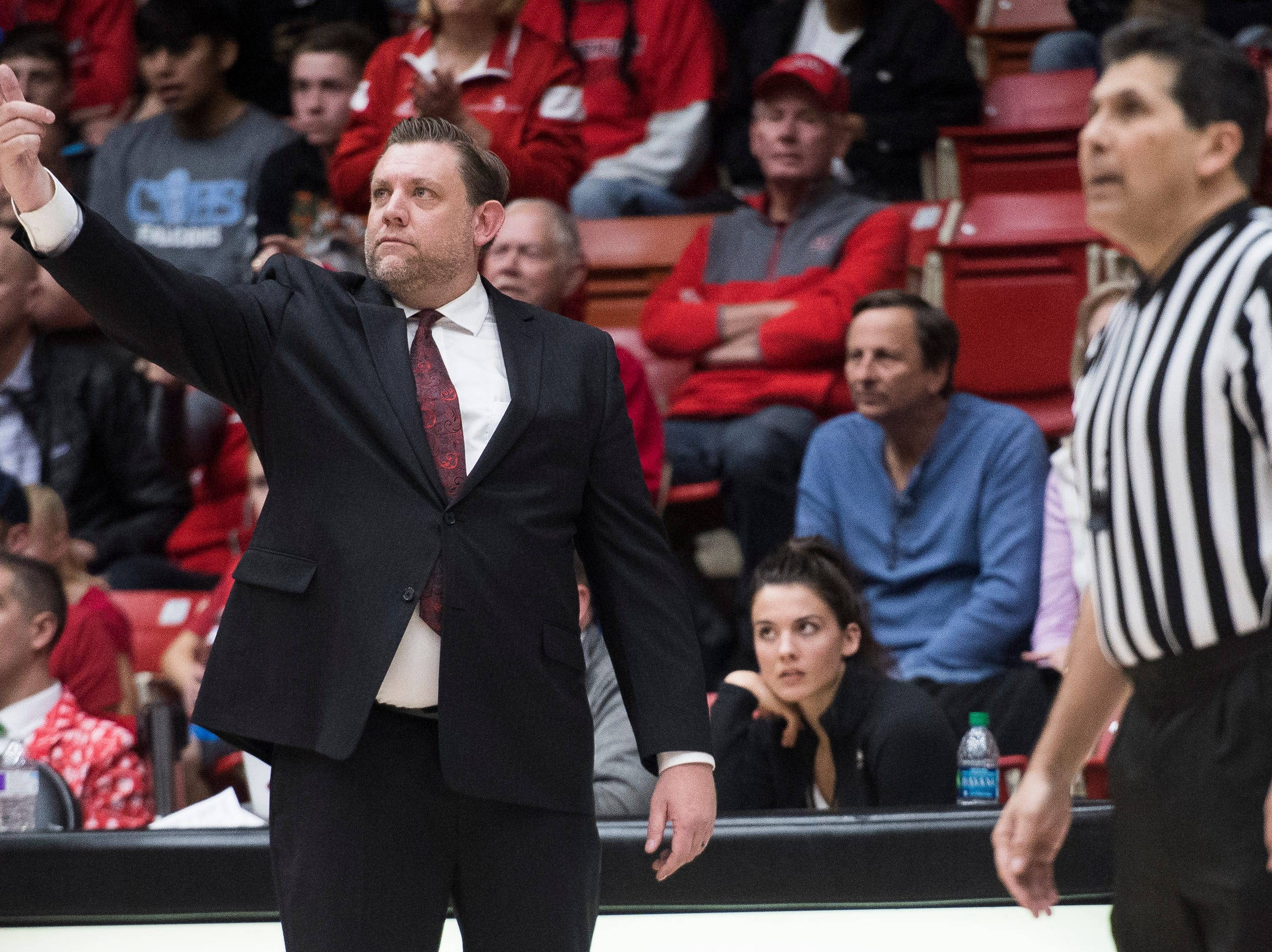Southern Utah University head coach Todd Simon gestures to the replay screen in protest of a penalty call during the game against Pepperdine University in the America First Event Center Saturday, December 15, 2018. SUU won in overtime, 78-69.