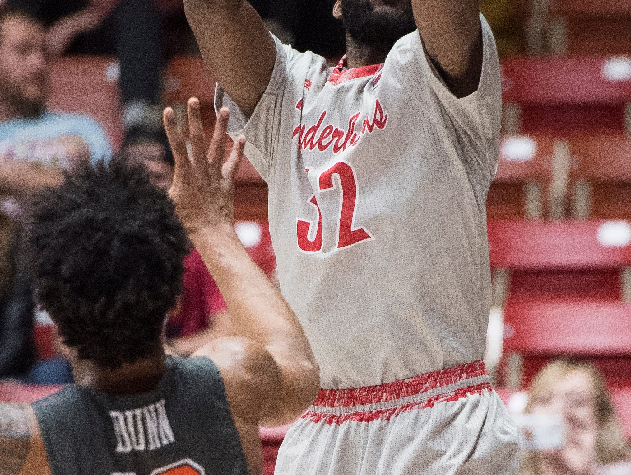 Southern Utah University junior Andre Adams (32) sinks a three-point shot against Pepperdine University in the America First Event Center Saturday, December 15, 2018. SUU won in overtime, 78-69.
