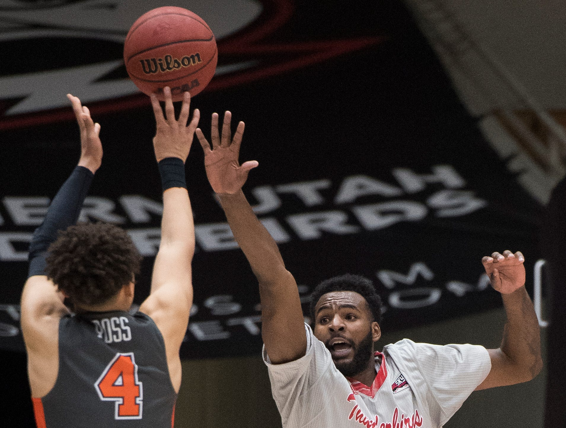 Southern Utah University junior Andre Adams (32) attempts to block a shot against Pepperdine University in the America First Event Center Saturday, December 15, 2018. SUU won in overtime, 78-69.