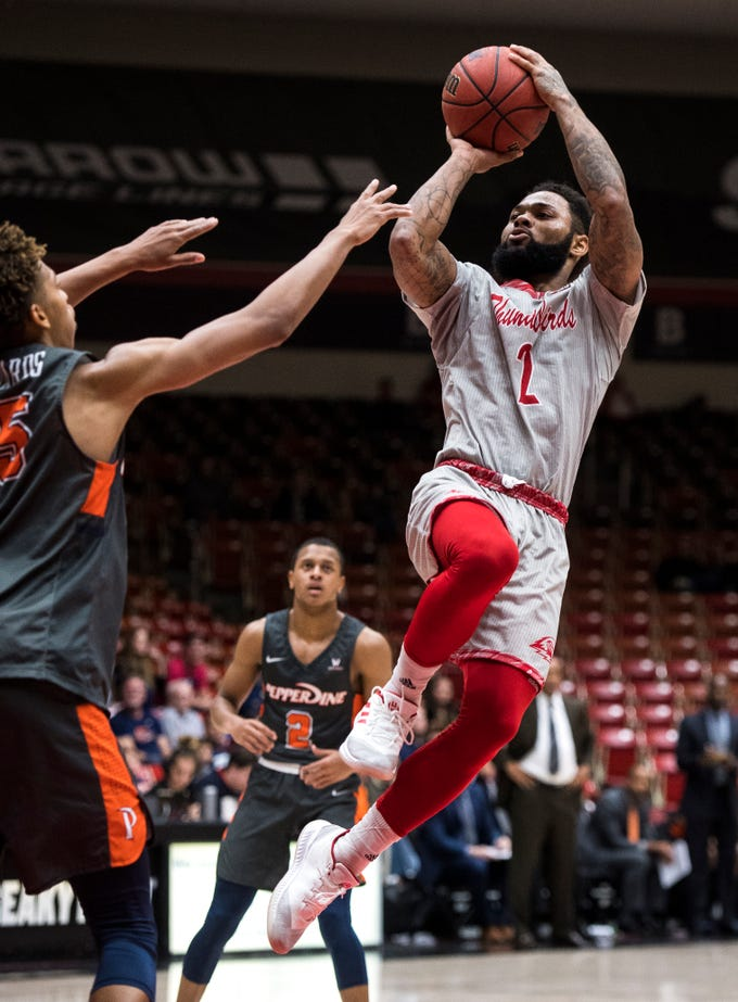 Southern Utah University freshman Kenton Eskridge (1) sinks a jump shot during the game against Pepperdine University in the America First Event Center Saturday, December 15, 2018. SUU won in overtime, 78-69.