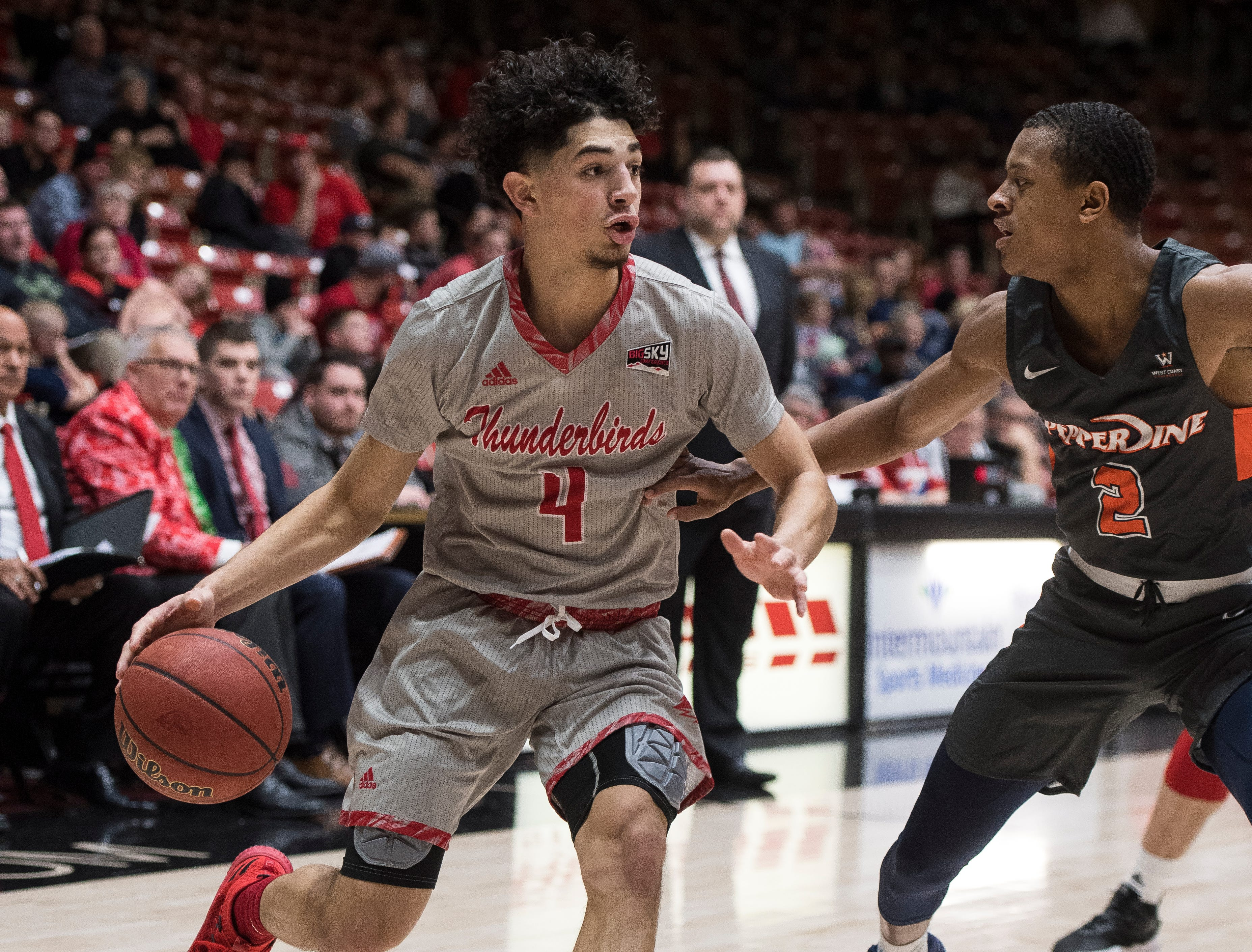 Southern Utah University sophomore Dre Marin (4) looks at his options against Pepperdine University in the America First Event Center Saturday, December 15, 2018. SUU won in overtime, 78-69.