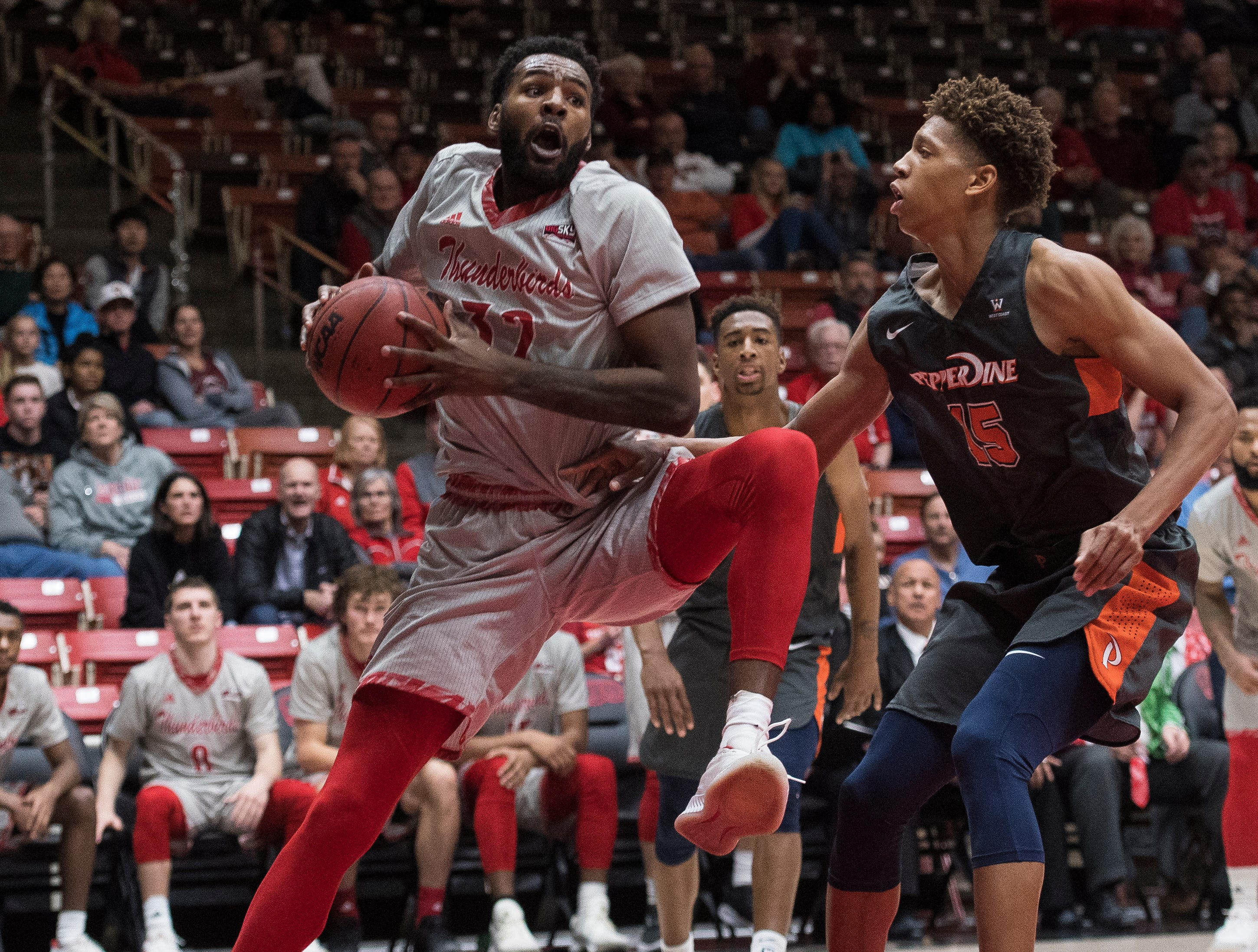 Southern Utah University junior Andre Adams (32) rebounds the ball against Pepperdine University in the America First Event Center Saturday, December 15, 2018. SUU won in overtime, 78-69.