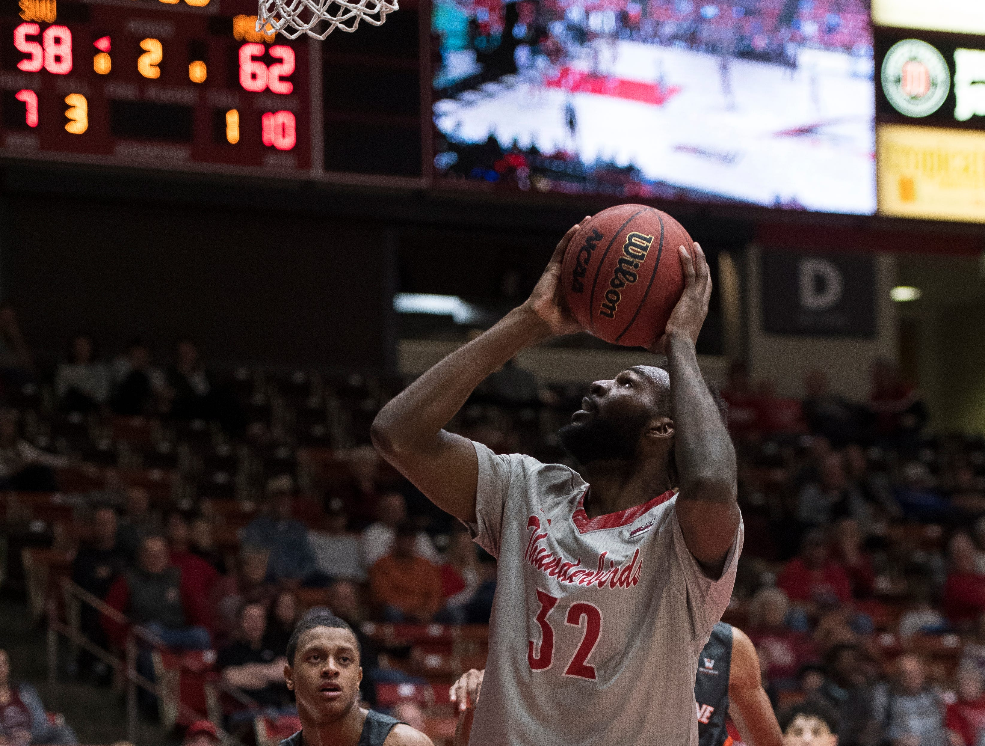 Southern Utah University junior Andre Adams (32) scores from under the basket against Pepperdine University in the America First Event Center Saturday, December 15, 2018. SUU won in overtime, 78-69.