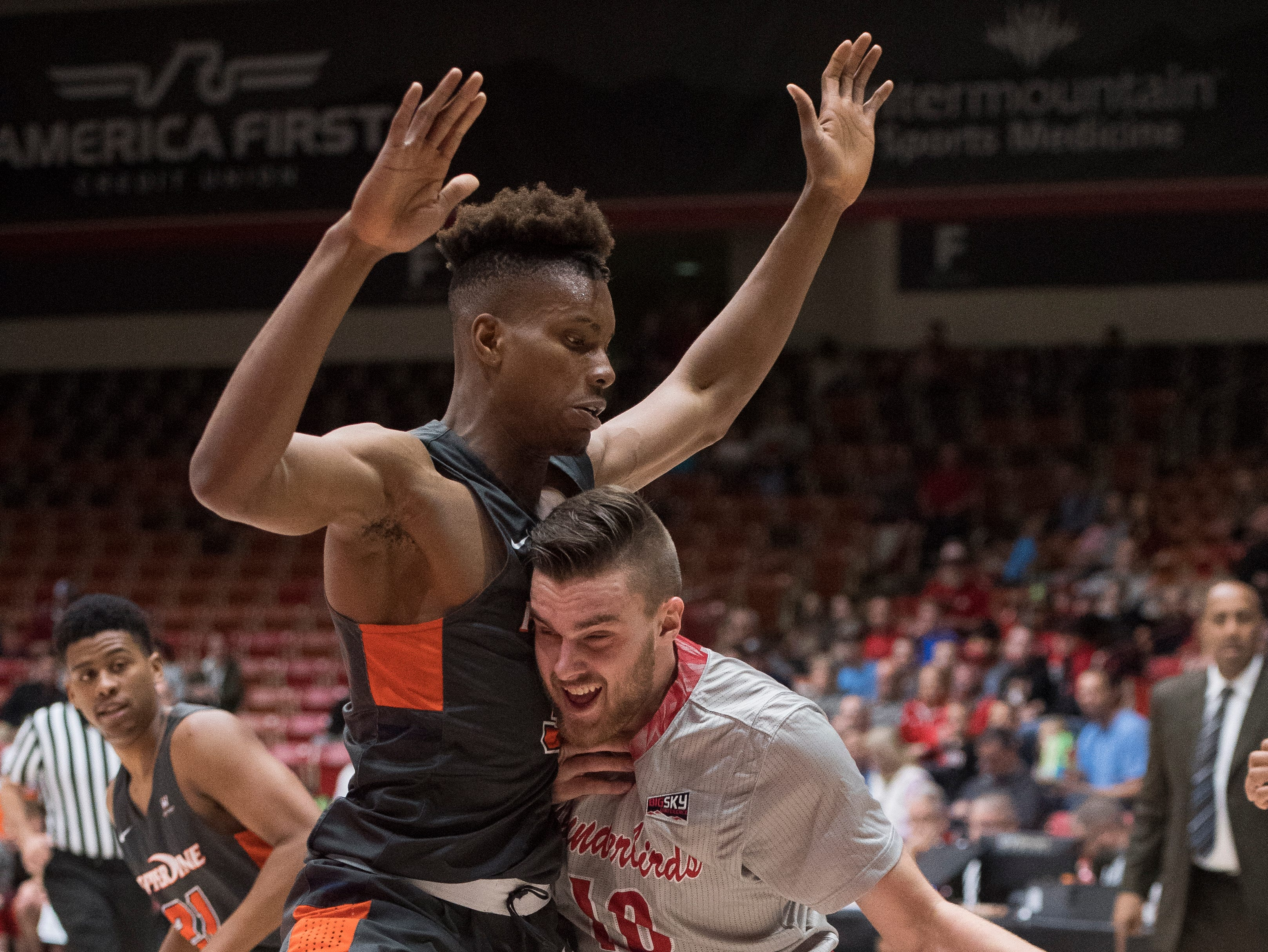 Southern Utah University junior Jacob Calloway (10) fights his way toward the basket during the game against Pepperdine University in the America First Event Center Saturday, December 15, 2018. SUU won in overtime, 78-69.