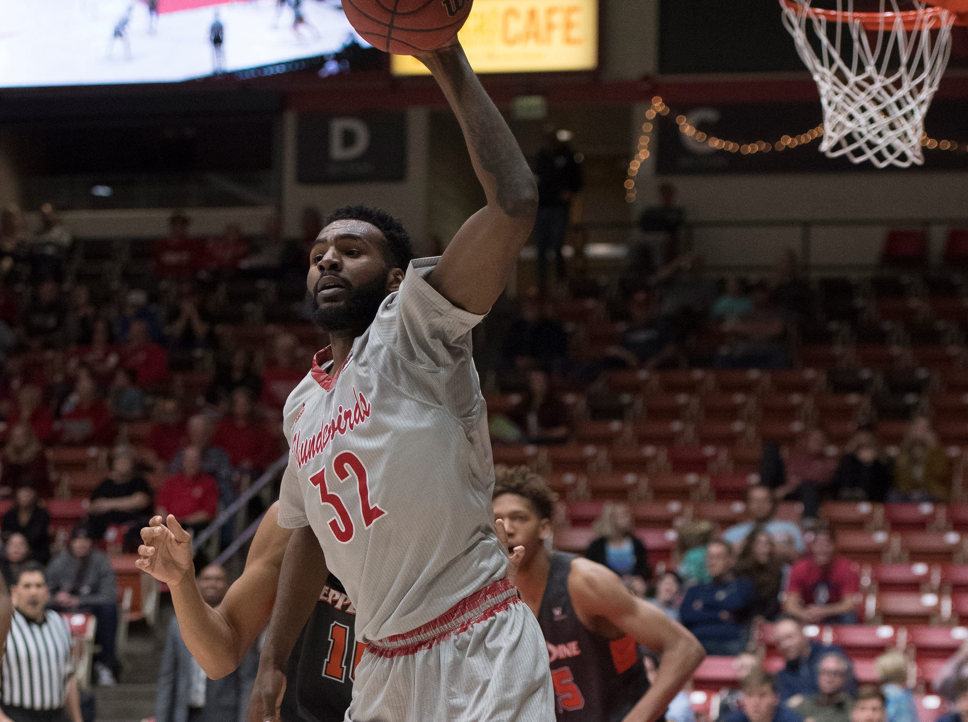Southern Utah University junior Andre Adams (32) catches a high pass during the game against Pepperdine University in the America First Event Center Saturday, December 15, 2018. SUU won in overtime, 78-69.