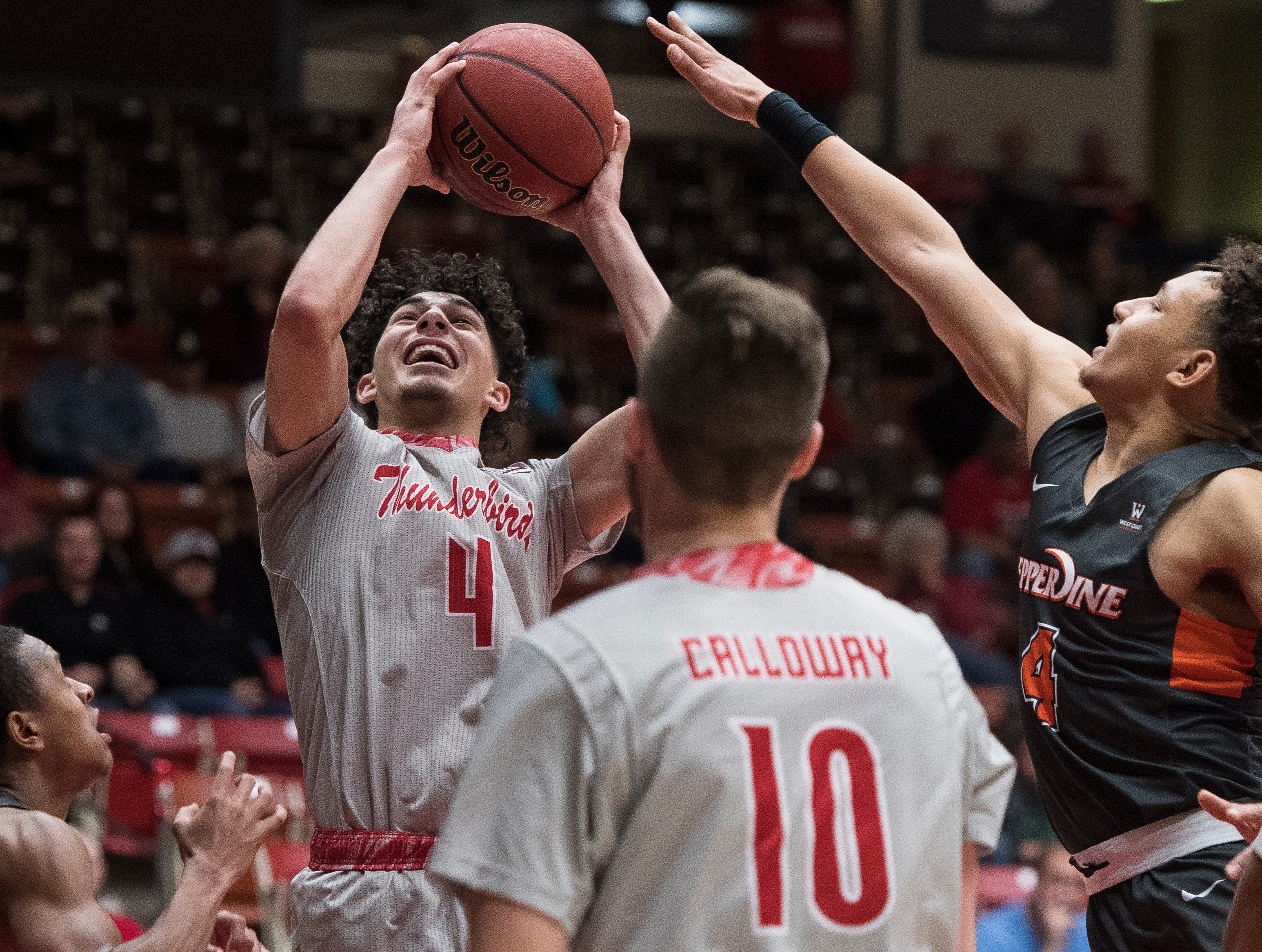 Southern Utah University sophomore Dre Marin (4) takes a shot against Pepperdine University in the America First Event Center Saturday, December 15, 2018. SUU won in overtime, 78-69.