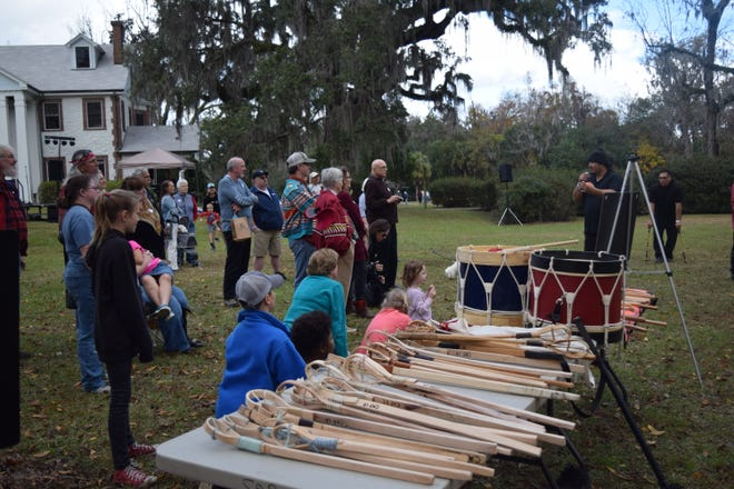 Winter Solstice Celebration attendees listen as the game of stickball is explained Saturday at Mission San Luis.