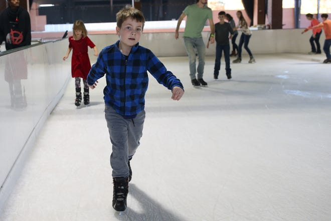 Gabriel Glasgow, 8, whizzes by while ice skating at the Pavillon, Saturday, Dec. 15, 2018.