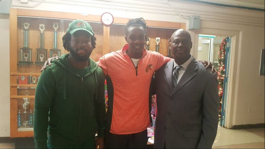 FAMU DB Terry Jefferson (left) and videographer A.J.Hicks stand alongside Carter-Parramore Academy principal Dr. Willie Jackson. They recently dropped off toys at the school in Quincy.