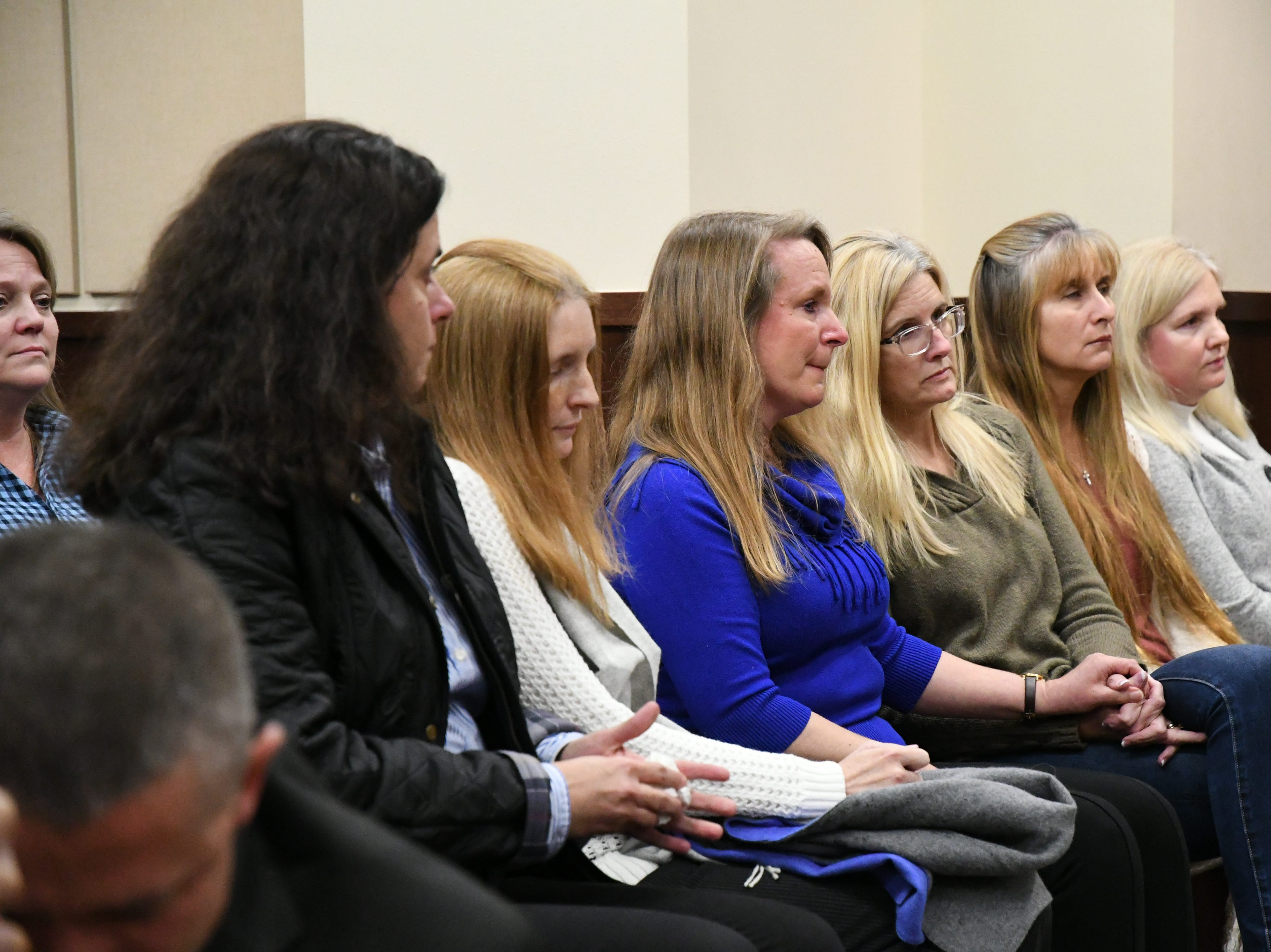 Family and friends of Denise Williams sit quietly as the guilty verdicts are read in the trial against Denise Williams for the murder of her husband Mike Williams, the man who was shot and killed by his best friend, Friday, Dec. 14, 2018.
