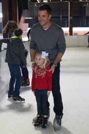 Jake Shanahan poses for a photo with his daughter Rielle Shanahan, 5, while ice skating at the Pavilion, Saturday, Dec. 15, 2018.