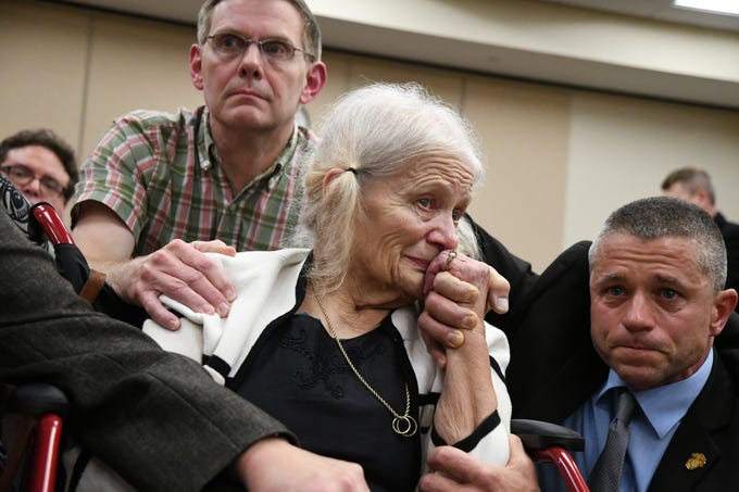 Nick Williams, left, brother of Mike Williams, the man who was shot and killed by his best friend 18 years ago, Cheryl Williams, center, mother of Mike Williams, along side family friend Josey Visnovske, cry tears of joy for a the guilty verdicts in the trial against Denise Williams, Mike's former wife, Friday, Dec. 14, 2018.
