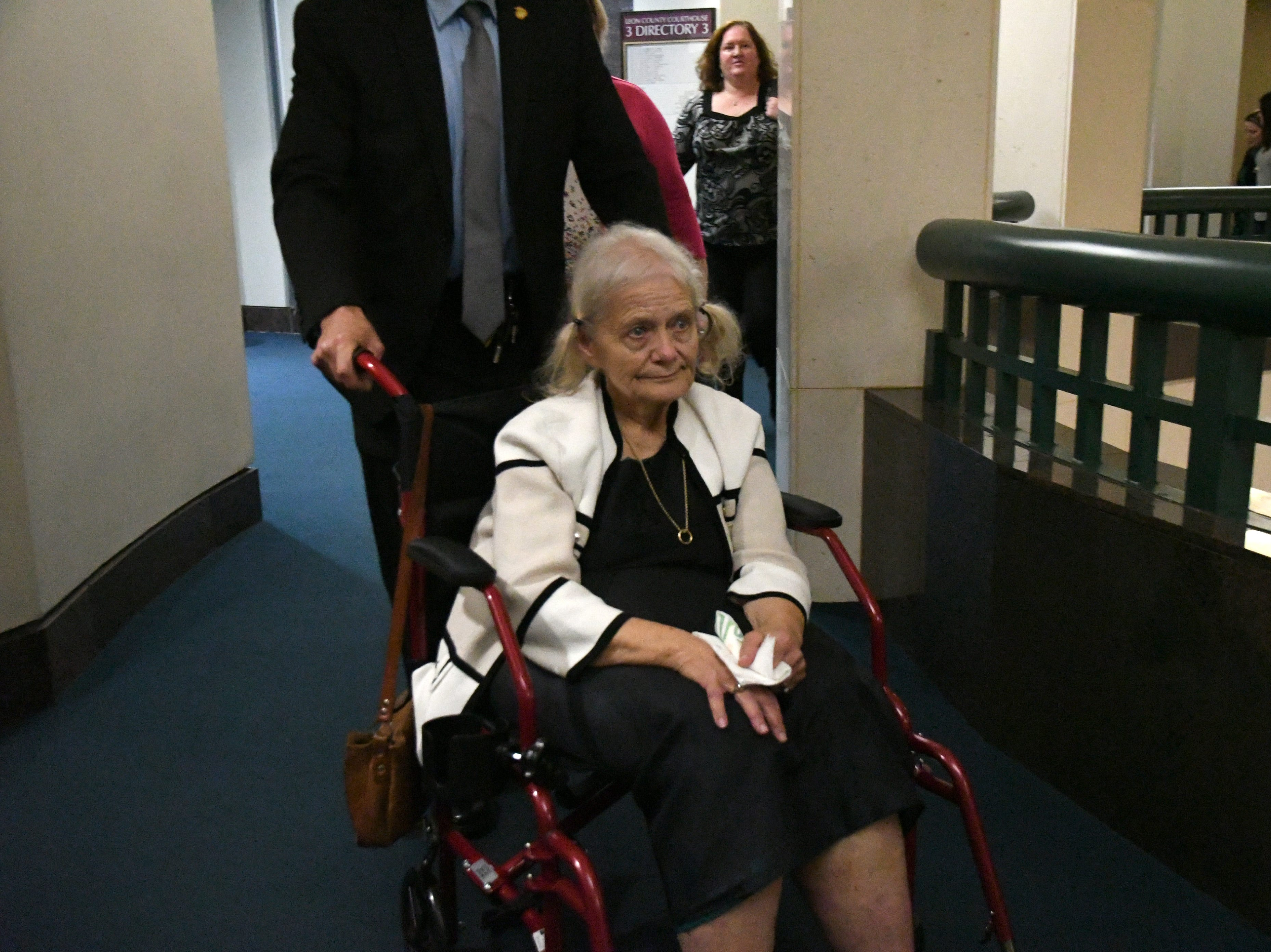 Cheryl Williams, mother of Mike Williams, the man who was shot and killed by his high school best friend Brian Winchester 18 years ago, gets wheeled into the courtroom to hear the verdict in the trial against Denise Williams for the murder of Mike Williams, Friday, Dec. 14, 2018.