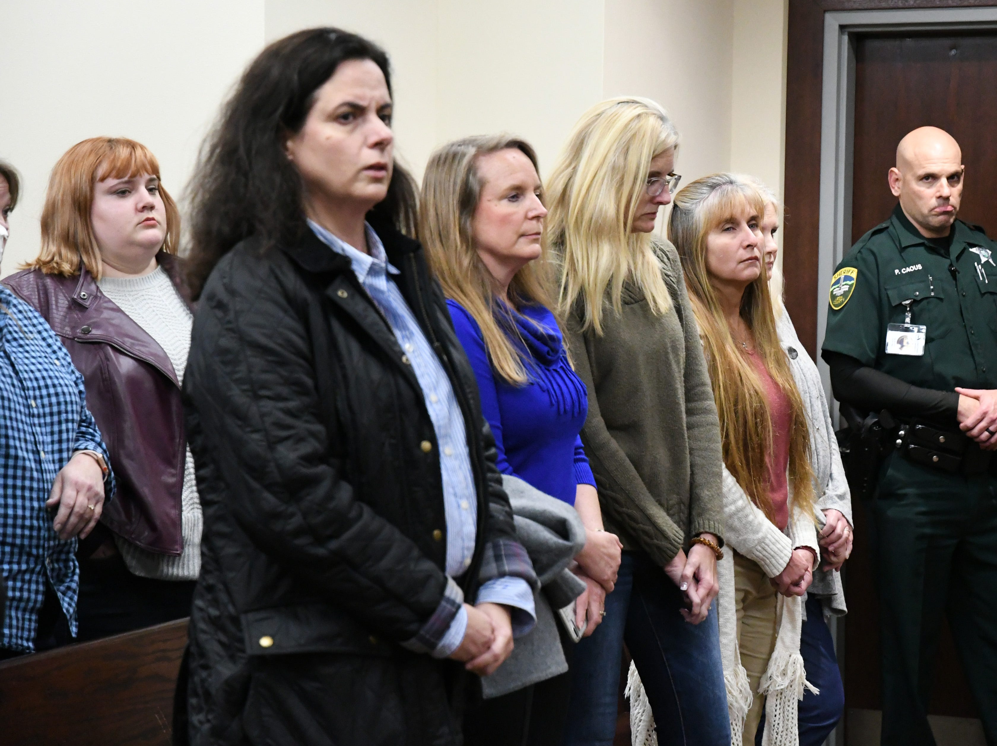 Family and friends of Denise Williams, the woman on trial for the murder of her late husband Mike Williams, await the verdicts from the jury, Friday, Dec. 14, 2018.