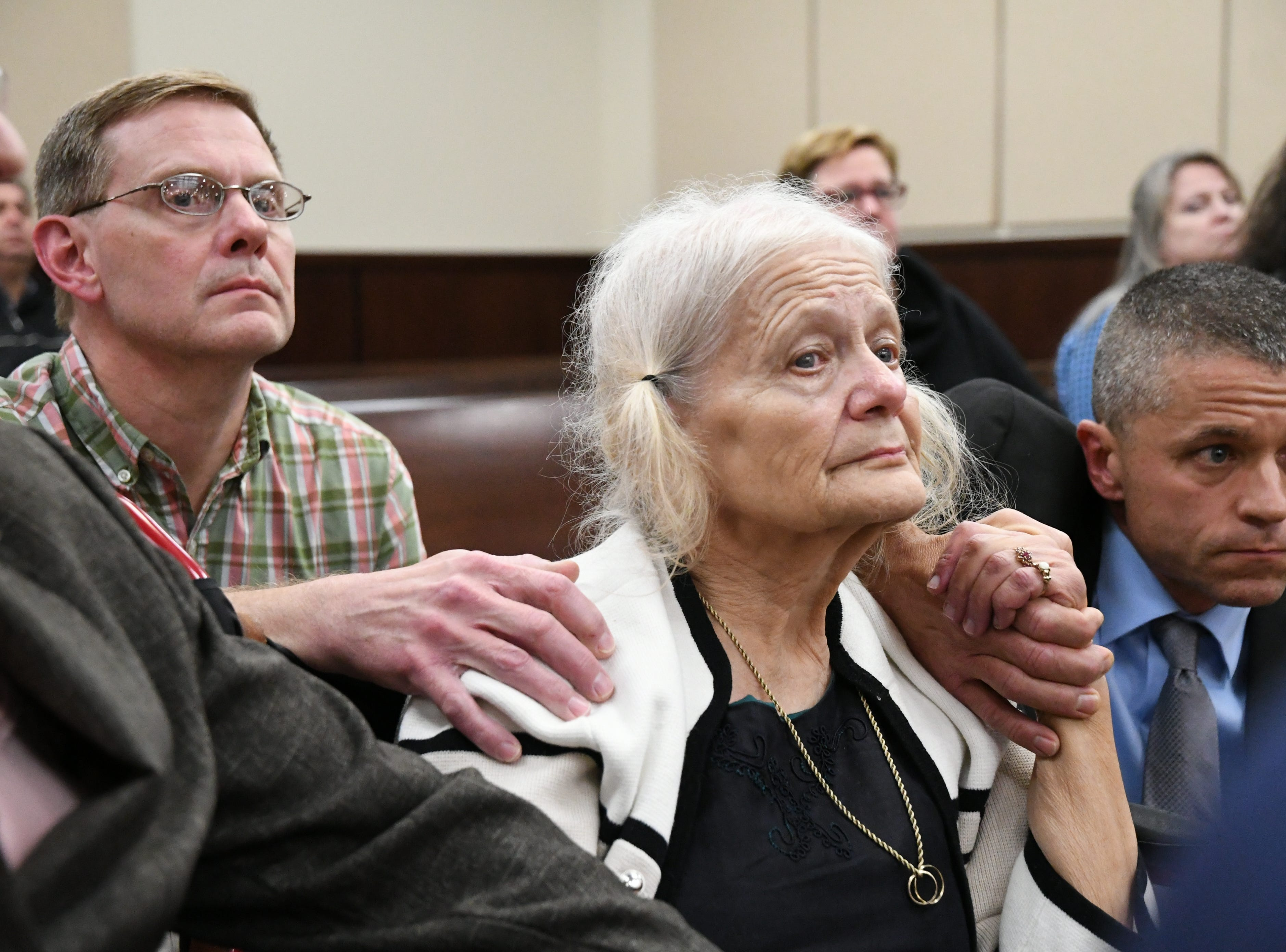 Nick Williams, left, brother of Mike Williams, the man who was shot and killed by his best friend Brian Winchester, 18 years ago, and his mother Cheryl Williams, center, mother of Mike Williams, full of hope, await the verdicts in the trial against Denise Williams, Mike's former wife, Friday, Dec. 14, 2018.