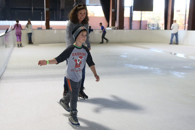 Elias Stely, 9, skates in front of his mom Genny Stely while ice skating at the Pavillon, Saturday, Dec. 15, 2018.