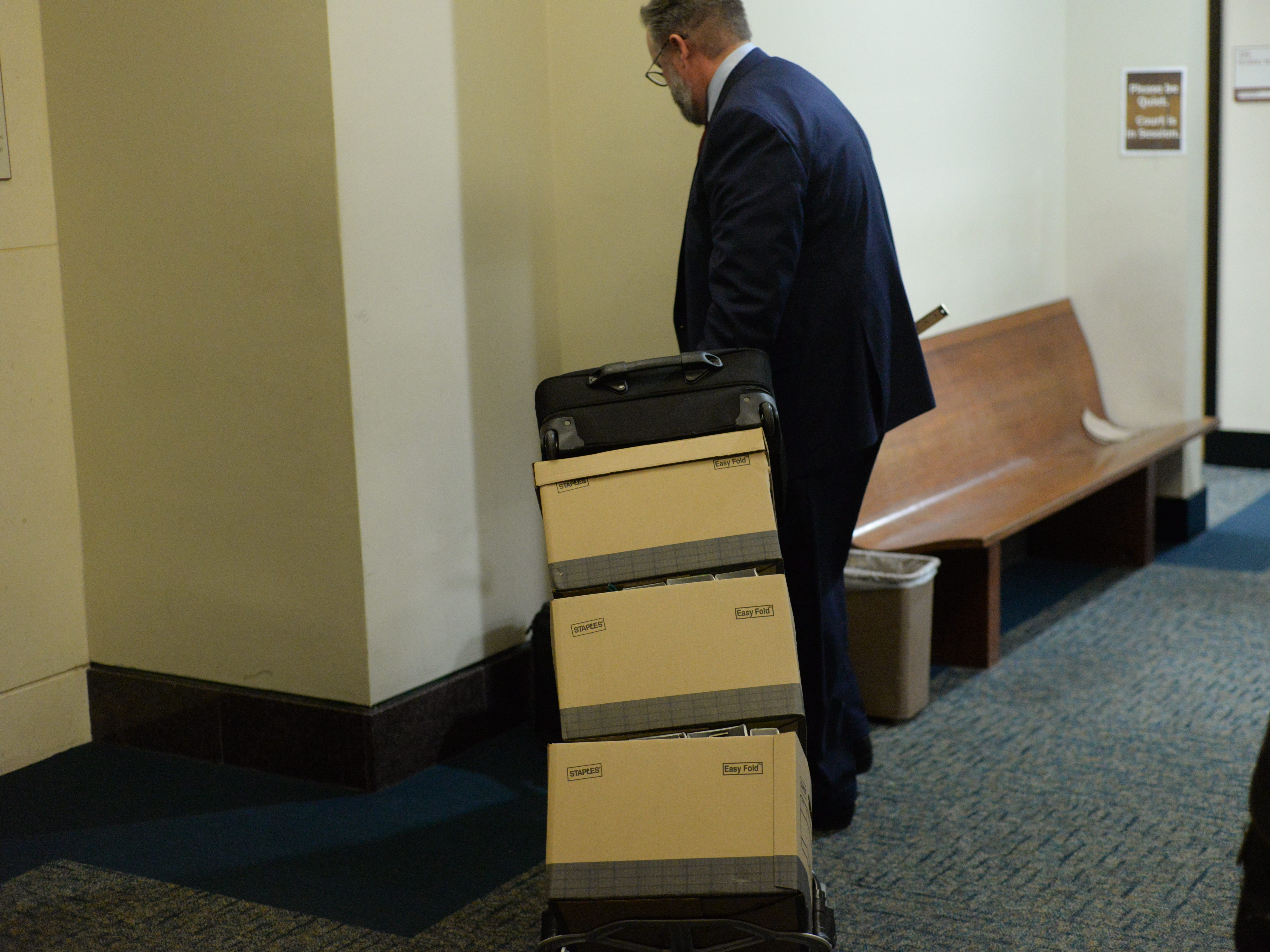 Attorney for Denise Williams, Ethan Way, packs up his case files after the verdict is read in the trial of Denise Williams, convicting her of the murder of her husband Mike Williams at the Leon County Courthouse Friday, Dec. 14, 2018.