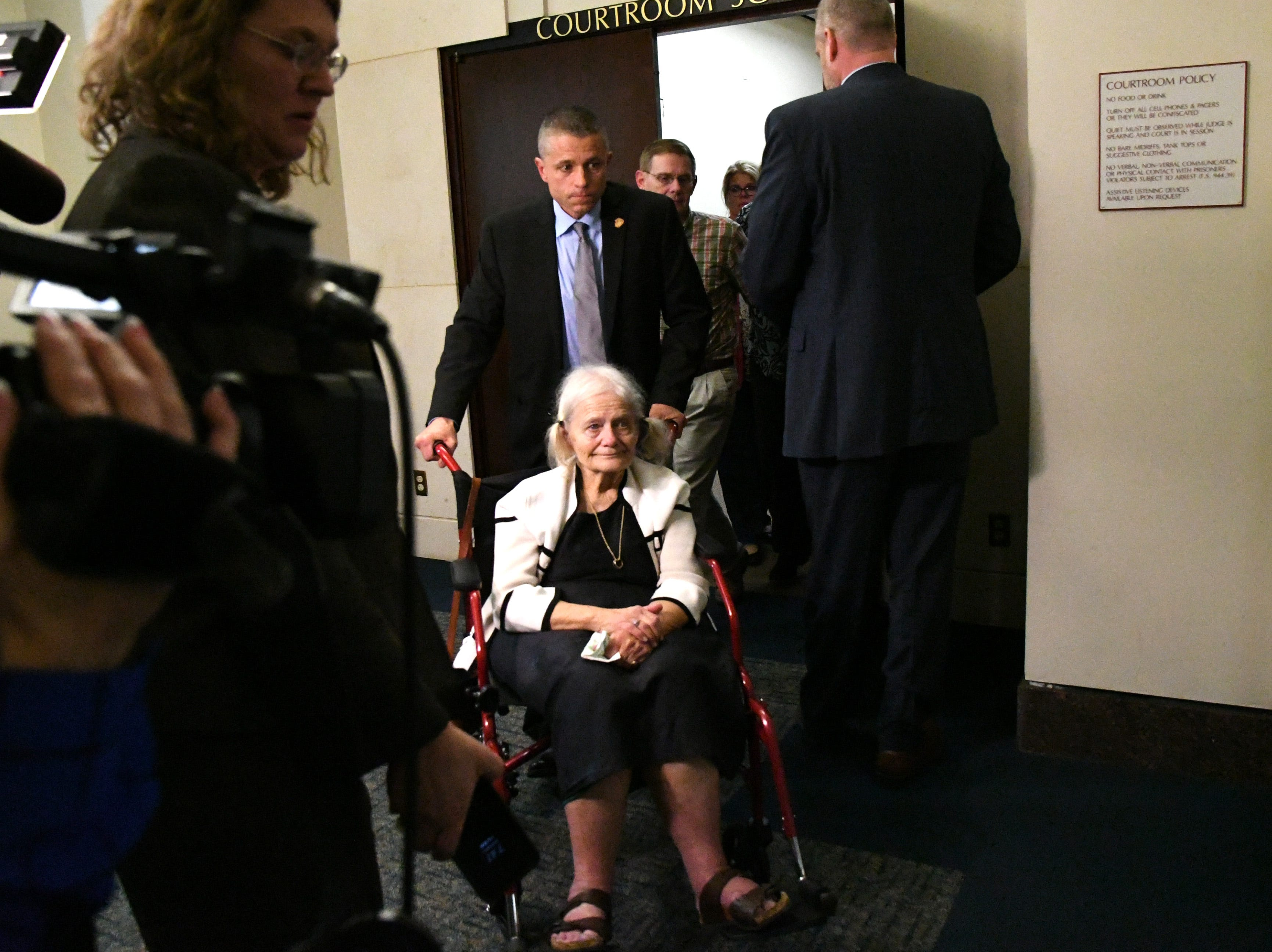 Cheryl Williams, mother of Mike Williams, the man who was shot and killed by his best friend Brian Winchester, gets wheeled out of the courtroom after hearing the guilty verdicts being read in the trial against Denise Williams for the murder of her husband Mike Williams, Friday, Dec. 14, 2018.