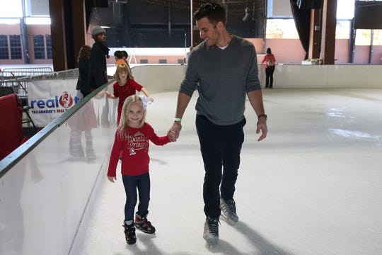 Jake Shanahan helps his daughter  Rielle Shanahan, 5, with ice skating at the Pavilion, Saturday, Dec. 15, 2018.