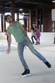 Michael Taylor does a spin on one skate while ice skating at the Pavillon, Saturday, Dec. 15, 2018.