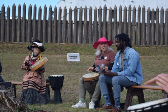 People gather for a drummers circle during the Winter Solstice event at Mission San Luis on Saturday.