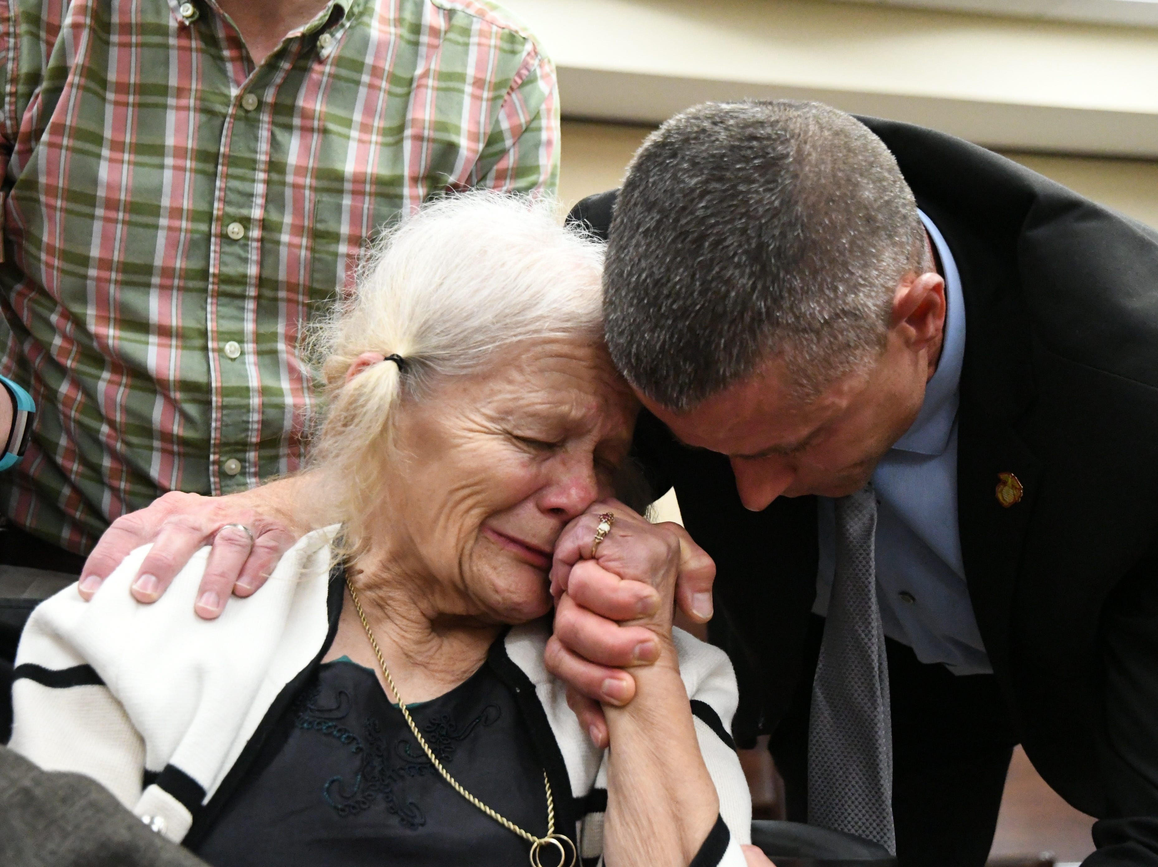 Cheryl Williams, left, mother of Mike Williams, the man who was shot and killed by his best friend 18 years ago, along side family friend Josey Visnovske, cry tears of joy for a the guilty verdicts in the trial against Denise Williams, Mike's former wife, Friday, Dec. 14, 2018.