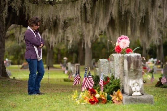 Wreaths Across America volunteers decorated veterans' burial sites at White City Cemetery on Saturday, Dec. 15, 2018, in Fort Pierce.
