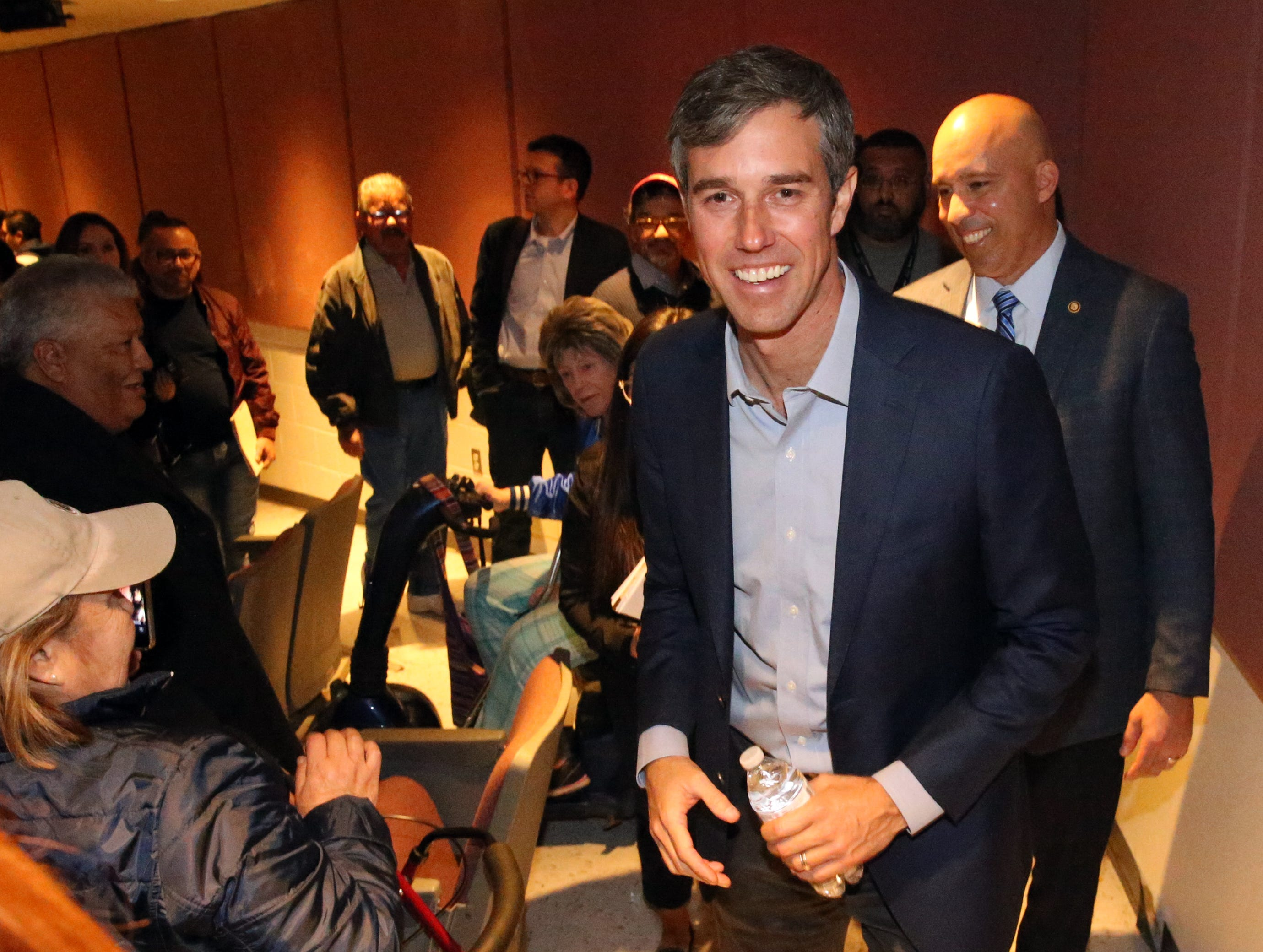 Congressman Beto O'Rourke exits the auditorium at Chapin High School after holding his final two town hall meetings there Friday.