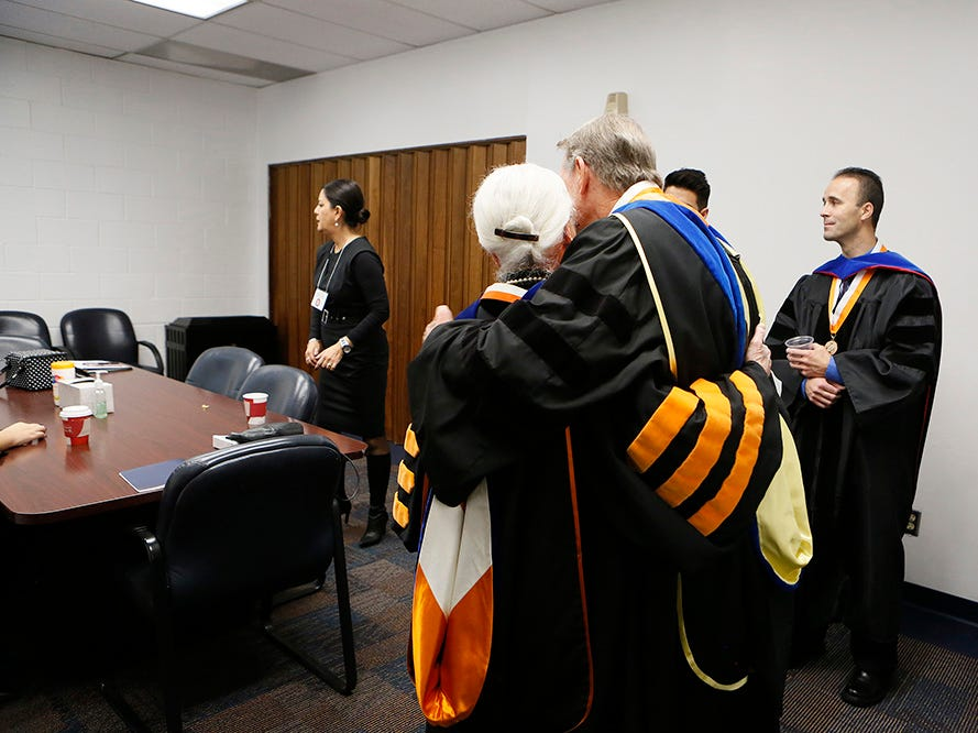 UTEP President Diana Natalicio gets a hug on the day of what likely will be her last commencement before retirement.
