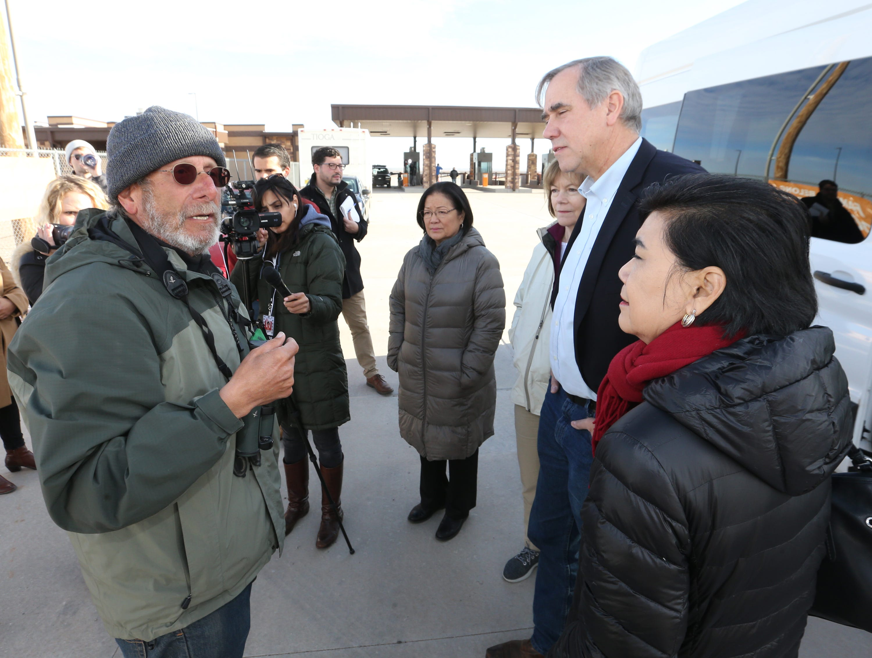 Joshua Rubin, left, of Brooklyn, N.Y. talks to members of Congress before they went in to tour the Tornillo international port of entry where more than 2,000 undocumented children are being housed Saturday. Rubin said he has been living outside the gates of the port in an RV for two months.