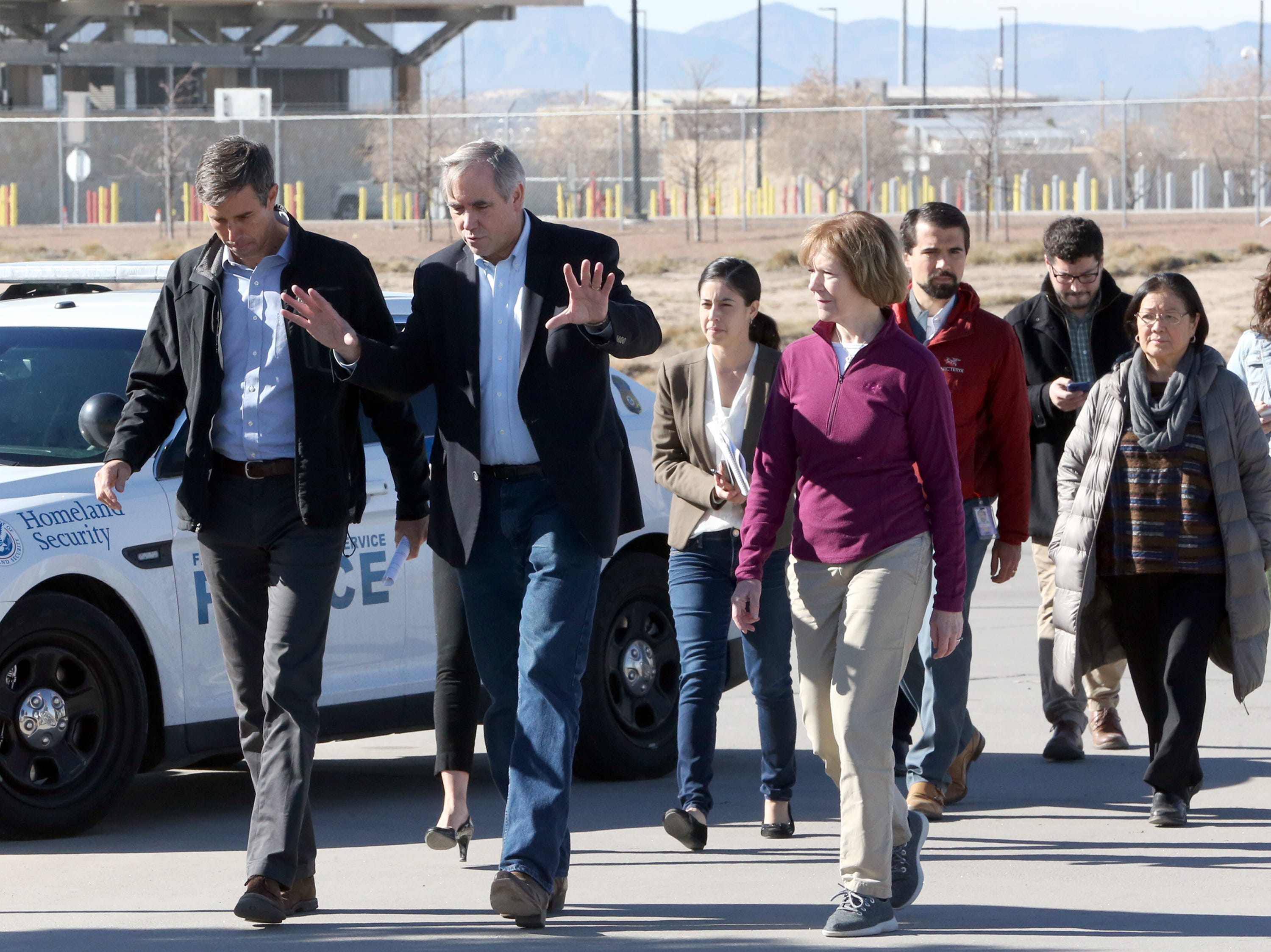 U.S. Rep. Beto O'Rourke, left, walks out of the Tornillo port of entry with Sen. Jeff Merkley, center, and other Democratic members of Congress who visited the area where more than 2,000 undocumented children are being housed Saturday.