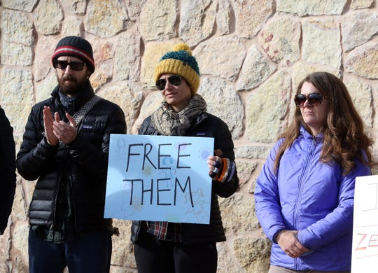 About 75 people, some holding signs, held a protest outside the gates to the Tornillo port of entry Saturday, Dec. 15, 2018.