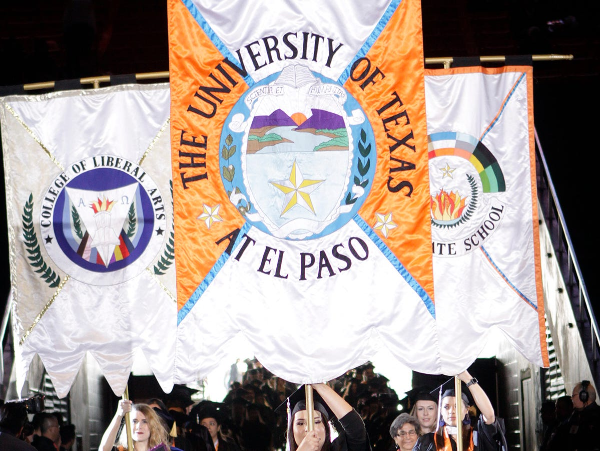 Proud students lead the way as more than 2,500 students received their degrees from the University of Texas at El Paso at Saturday's winter commencement ceremonies.