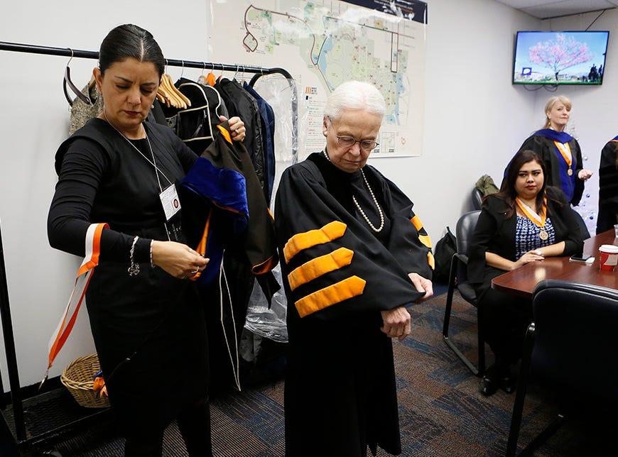 UTEP President Diana Natalicio adjusts her robe Saturday.