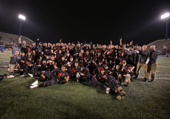 Grace Brethren poses for a photo after winning the Division 2AA state football championship Friday night at Cerritos College.