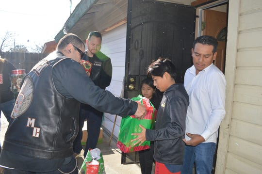 La Raza Motorcycle Club toy delivery in Visalia