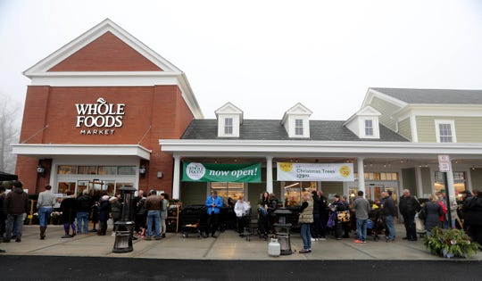 Shoppers wait outside Whole Foods at Chappaqua Crossing before the store's grand opening Dec. 15, 2018. The 40,000 square foot store opened to shoppers on the site of the formers Readers Digest headquarters. The New Castle Town Board and Planning Board approved a temporary traffic plan for the Route 117-Roaring Brook Road intersection that allowed the store to open.