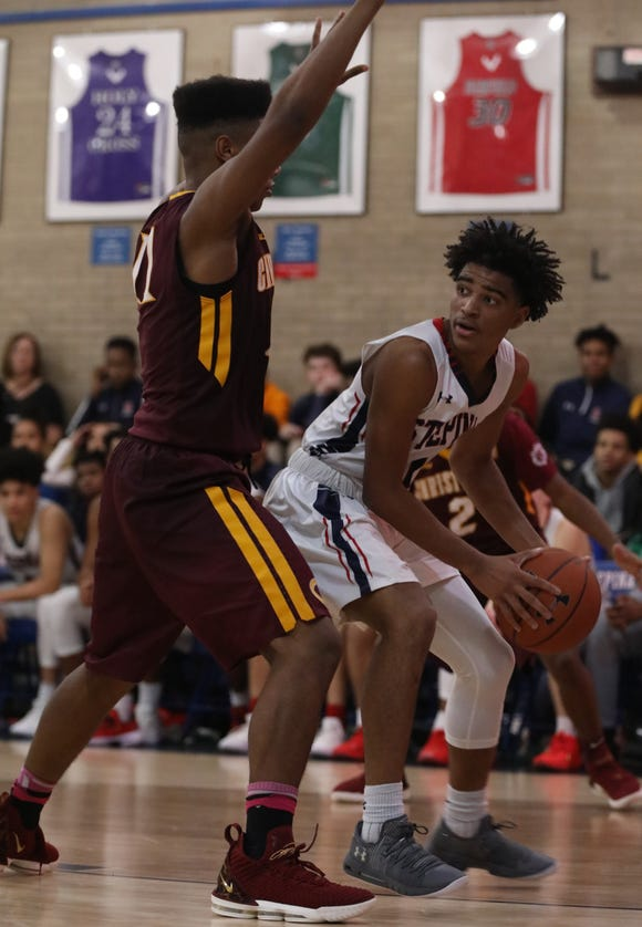 Stepinac 's RJ Davis (1) looks for an open teammate during boys basketball game at Stepinac High School in White Plains Dec.14, 2018, Christ the King defeats Stepinac 85-69.