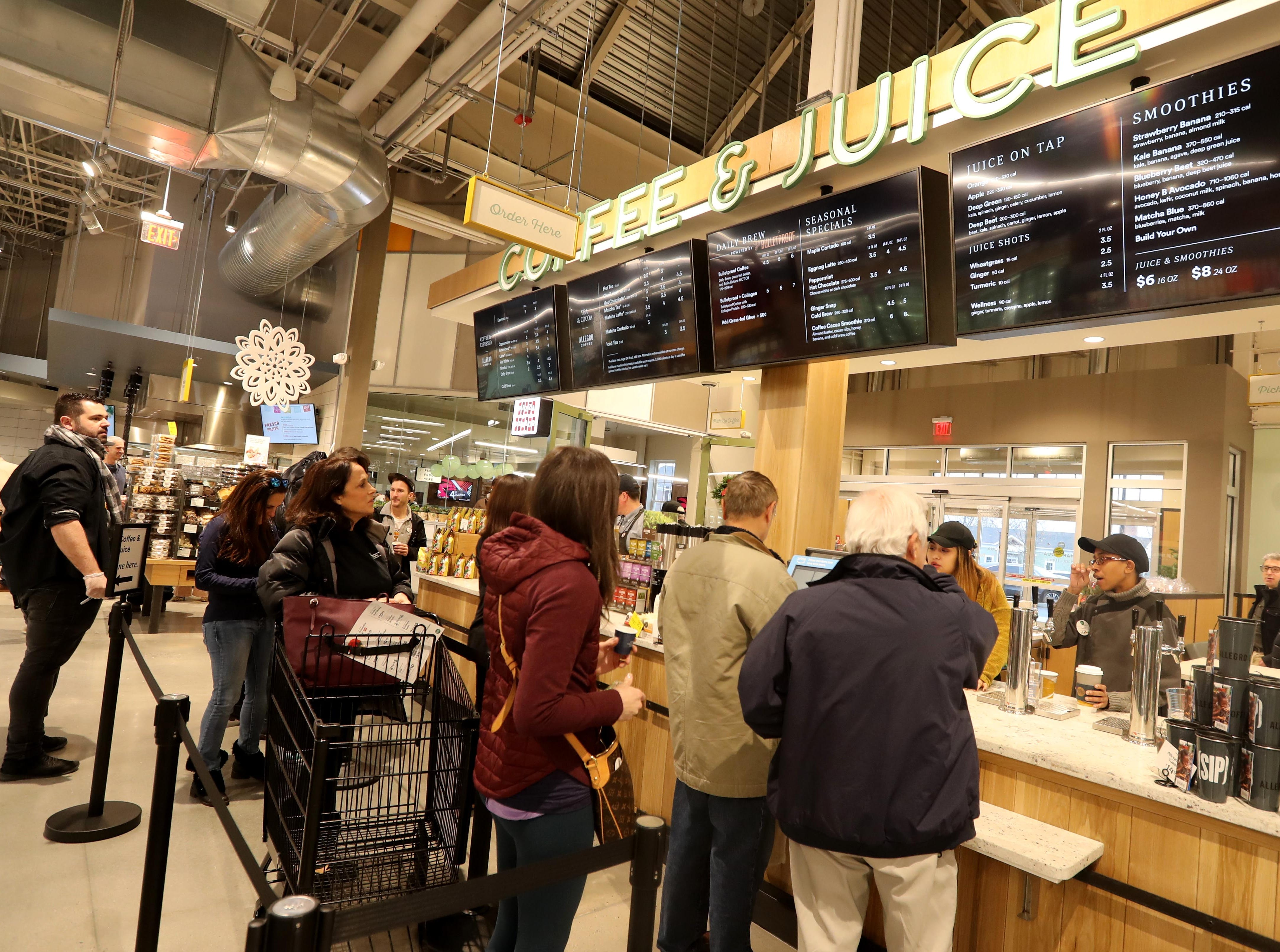 Shoppers stop by the coffee and juice bar at the new Whole Foods in Chappaqua Dec. 15, 2018. The 40,000 square foot store opened to shoppers on the site of the formers Readers Digest headquarters. The New Castle Town Board and Planning Board approved a temporary traffic plan for the Route 117-Roaring Brook Road intersection that allowed the store to open.