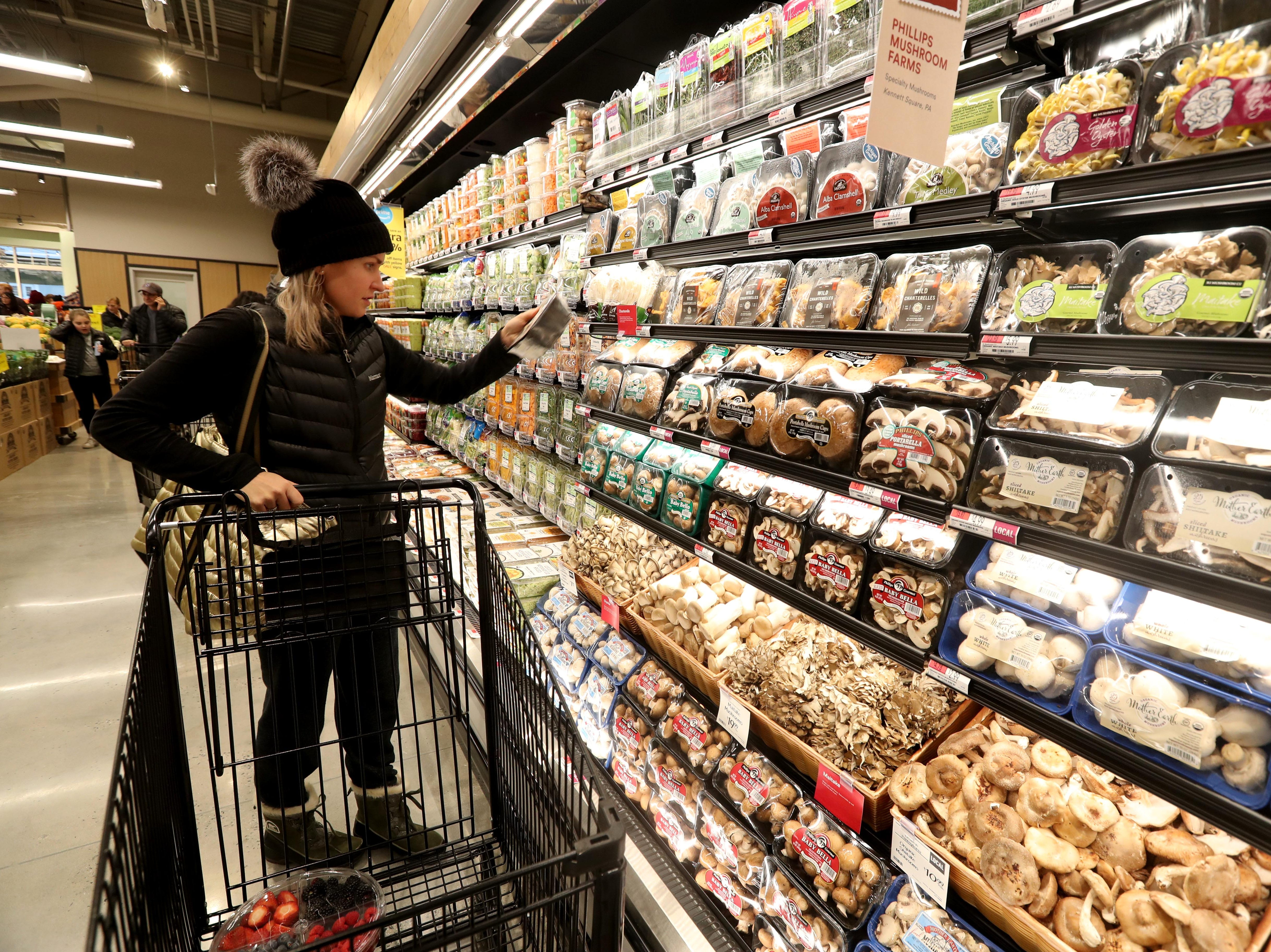Kristine Rothman of Chappaqua shops in the produce section of the new Whole Foods in Chappaqua shortly after the grand opening of the supermarket at Chappaqua Crossing  Dec. 15, 2018. The 40,000 square foot store opened to shoppers on the site of the formers Readers Digest headquarters. The New Castle Town Board and Planning Board approved a temporary traffic plan for the Route 117-Roaring Brook Road intersection that allowed the store to open.
