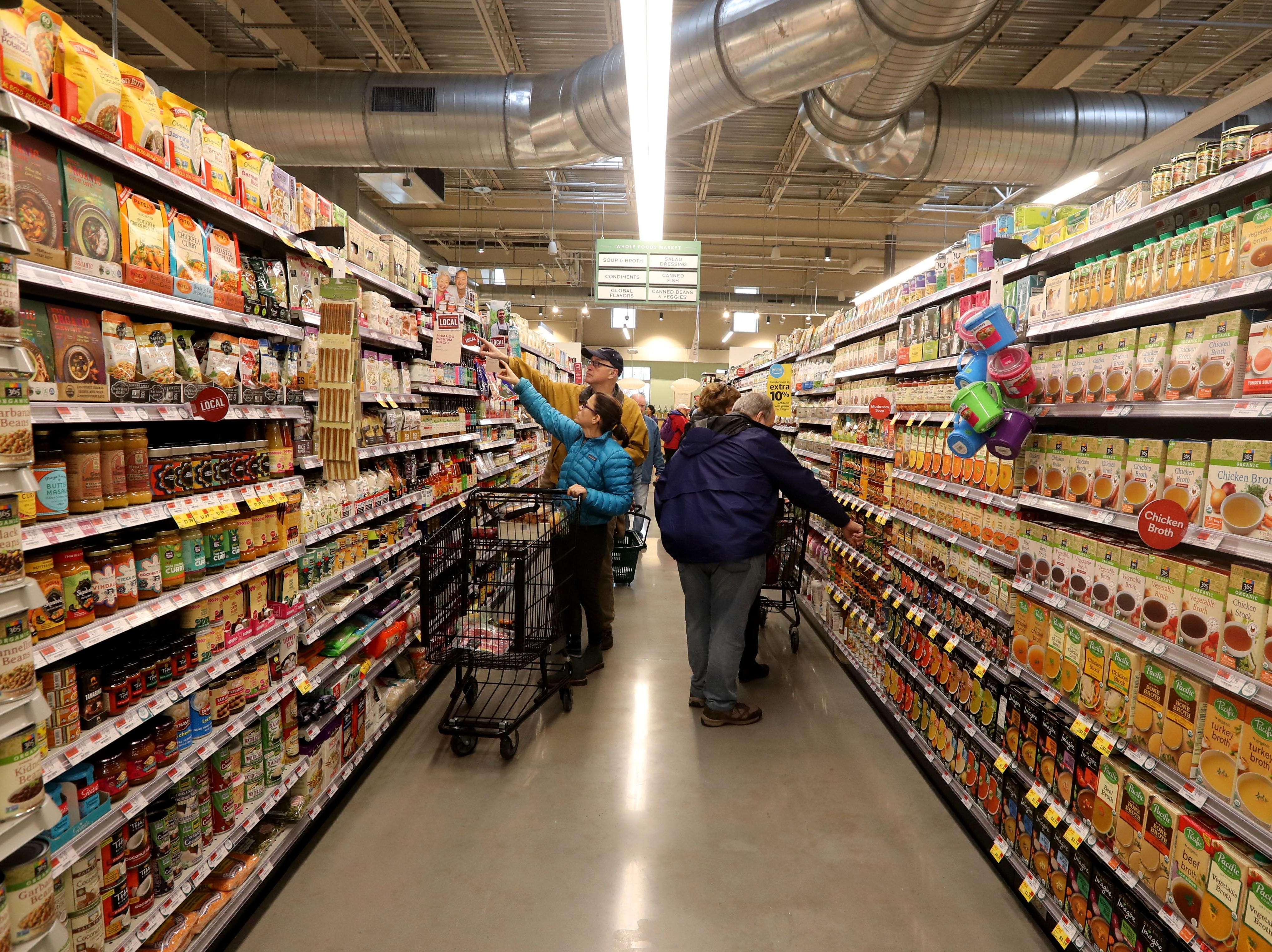 Shoppers make their way through the aisles at the new Whole Foods in Chappaqua Dec. 15, 2018. The 40,000 square foot store opened to shoppers on the site of the formers Readers Digest headquarters. The New Castle Town Board and Planning Board approved a temporary traffic plan for the Route 117-Roaring Brook Road intersection that allowed the store to open.