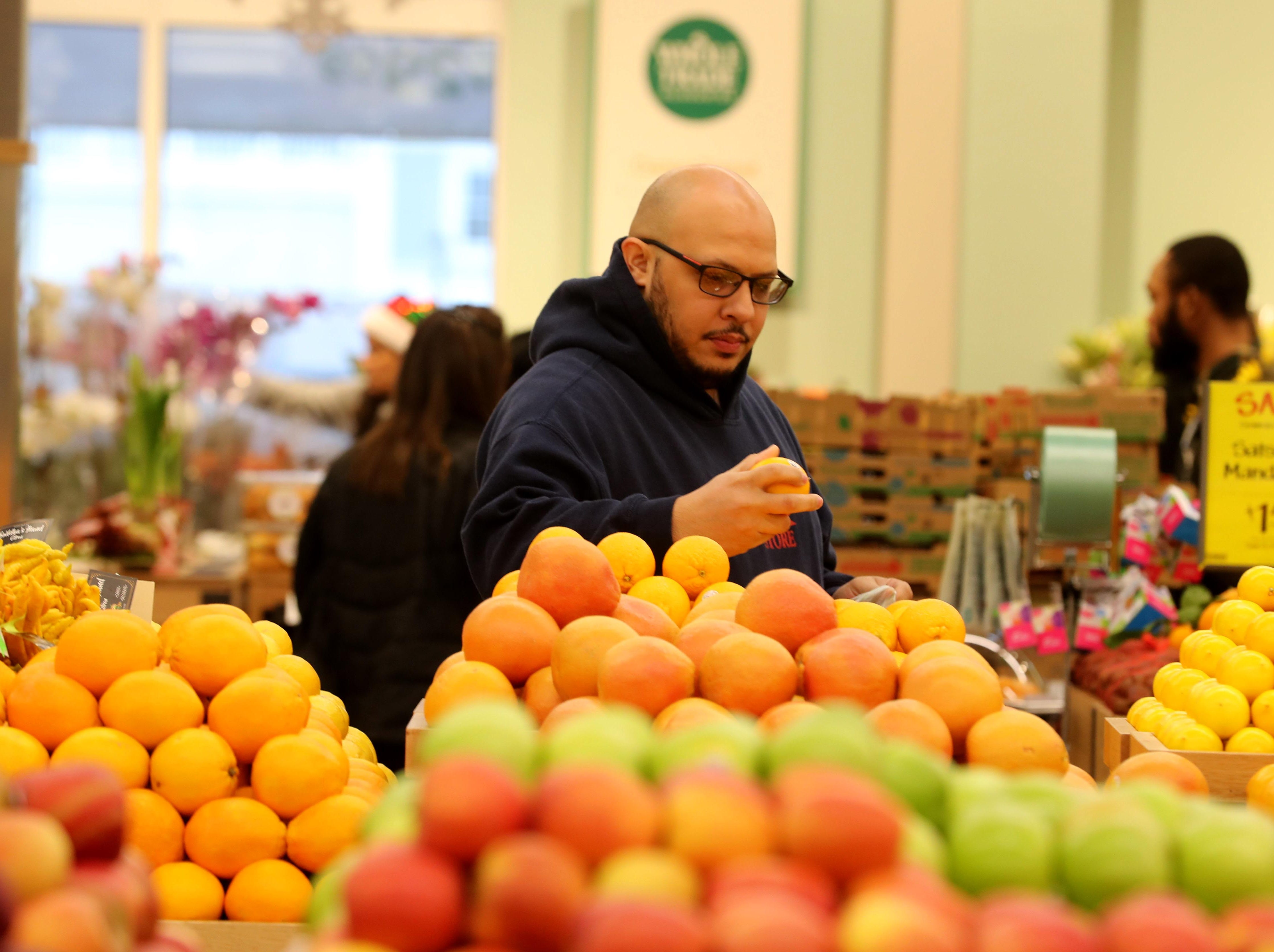 Michael Tapia of Yorktown shops for produce at the new Whole Foods in Chappaqua Dec. 15, 2018. The 40,000 square foot store opened to shoppers on the site of the formers Readers Digest headquarters. The New Castle Town Board and Planning Board approved a temporary traffic plan for the Route 117-Roaring Brook Road intersection that allowed the store to open.