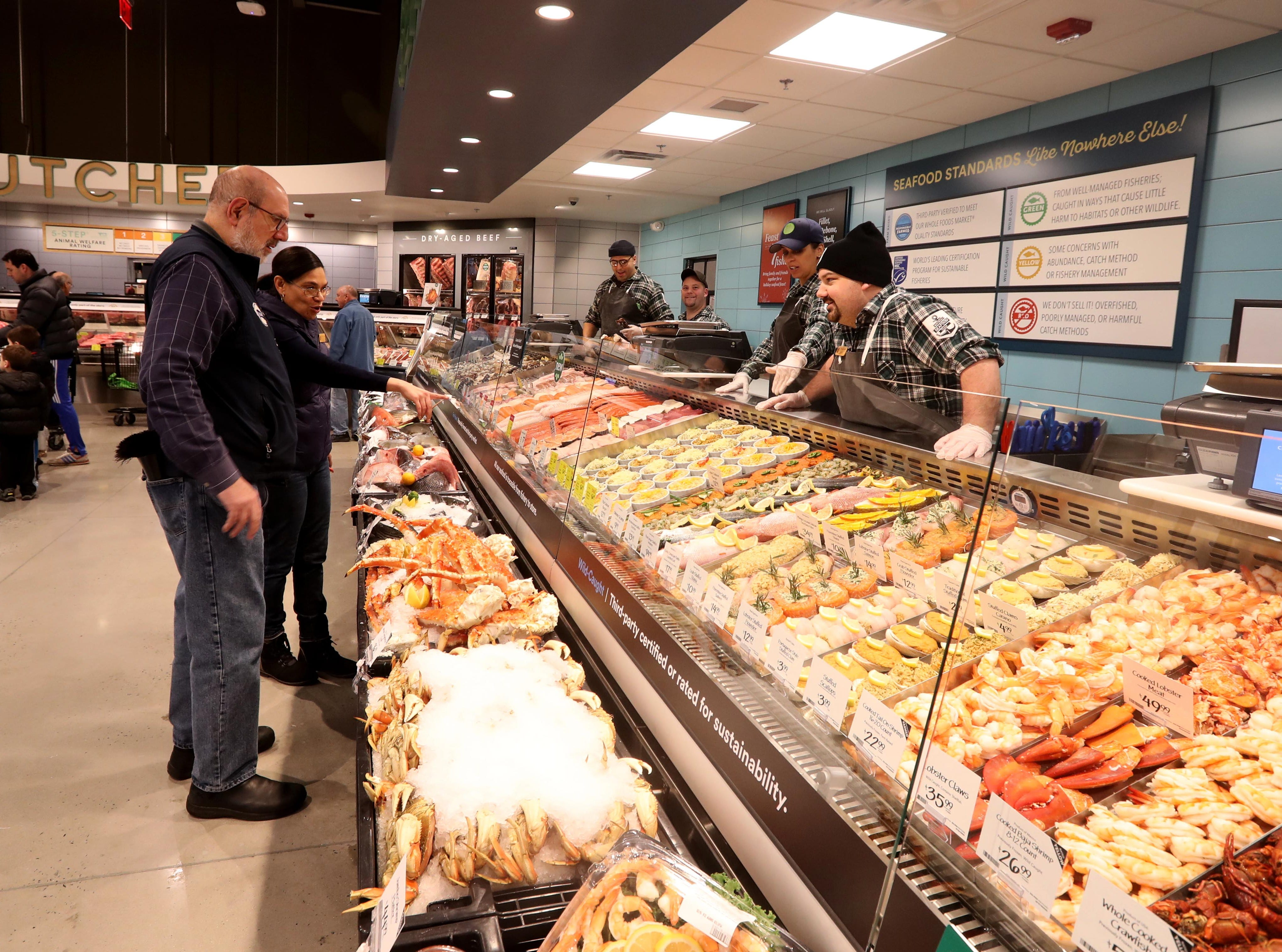 Shoppers browse the seafood section at the new Whole Foods in Chappaqua Dec. 15, 2018. The 40,000 square foot store opened to shoppers on the site of the formers Readers Digest headquarters. The New Castle Town Board and Planning Board approved a temporary traffic plan for the Route 117-Roaring Brook Road intersection that allowed the store to open.