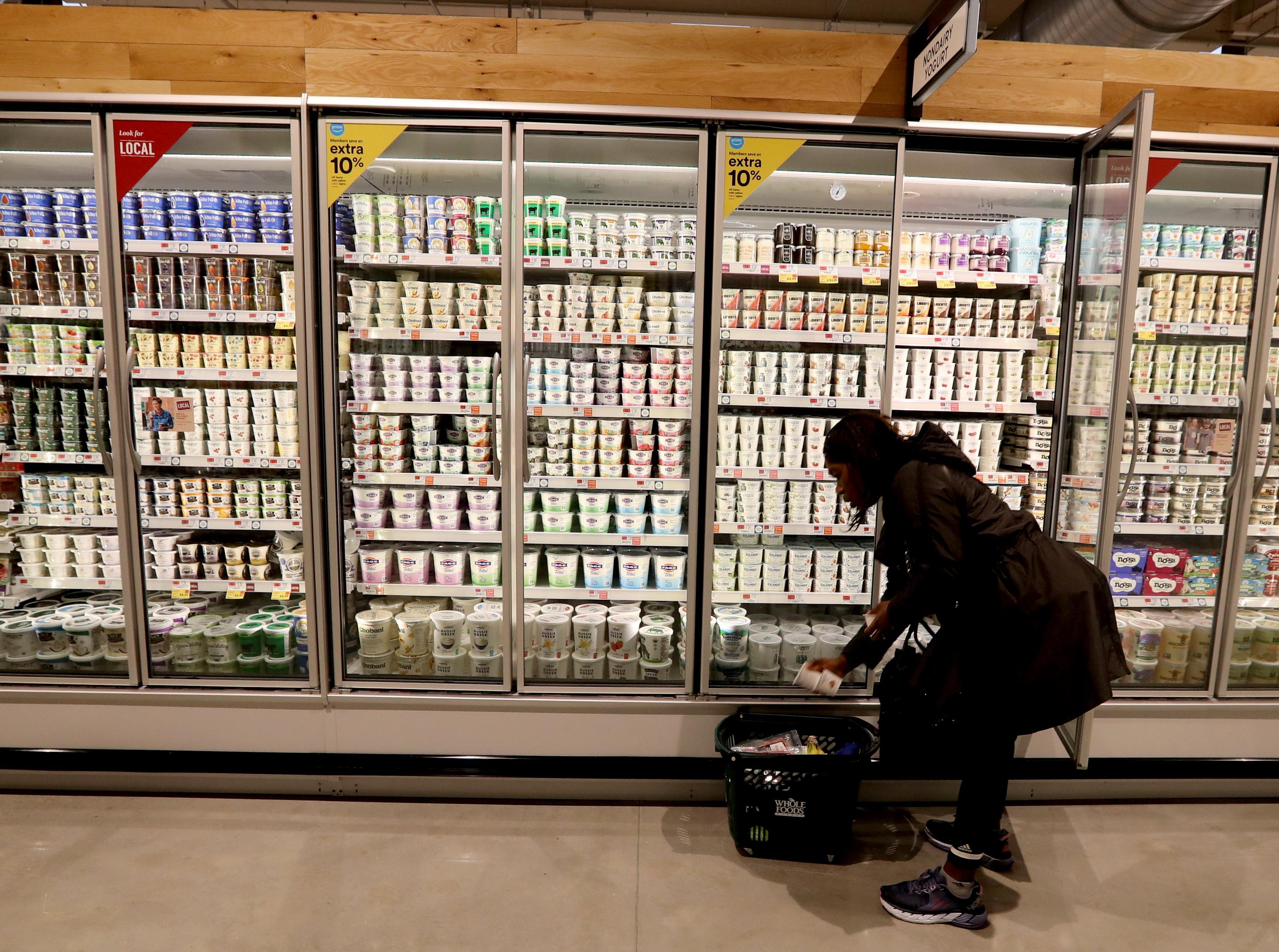 Ngozi Okezie of Chappaqua shops in the produce section of the new Whole Foods in Chappaqua shortly after the grand opening of the supermarket at Chappaqua Crossing  Dec. 15, 2018. The 40,000 square foot store opened to shoppers on the site of the formers Readers Digest headquarters. The New Castle Town Board and Planning Board approved a temporary traffic plan for the Route 117-Roaring Brook Road intersection that allowed the store to open.