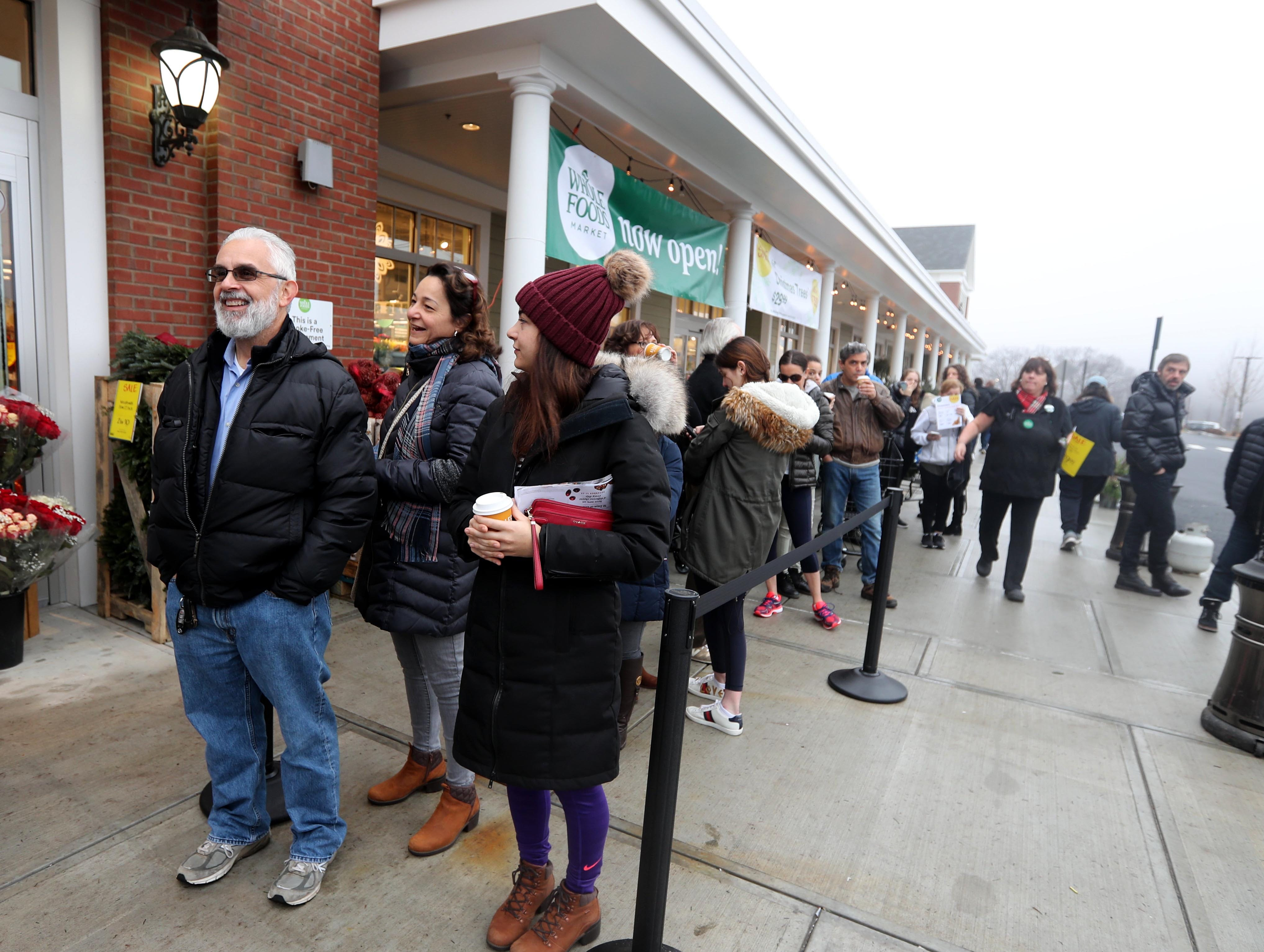 Frank and Stephanie Pate of Pleasantville, along with their daughter Erica, were first in line as shoppers waited outside Whole Foods at Chappaqua Crossing before the store's grand opening Dec. 15, 2018. The 40,000 square foot store opened to shoppers on the site of the formers Readers Digest headquarters. The New Castle Town Board and Planning Board approved a temporary traffic plan for the Route 117-Roaring Brook Road intersection that allowed the store to open.