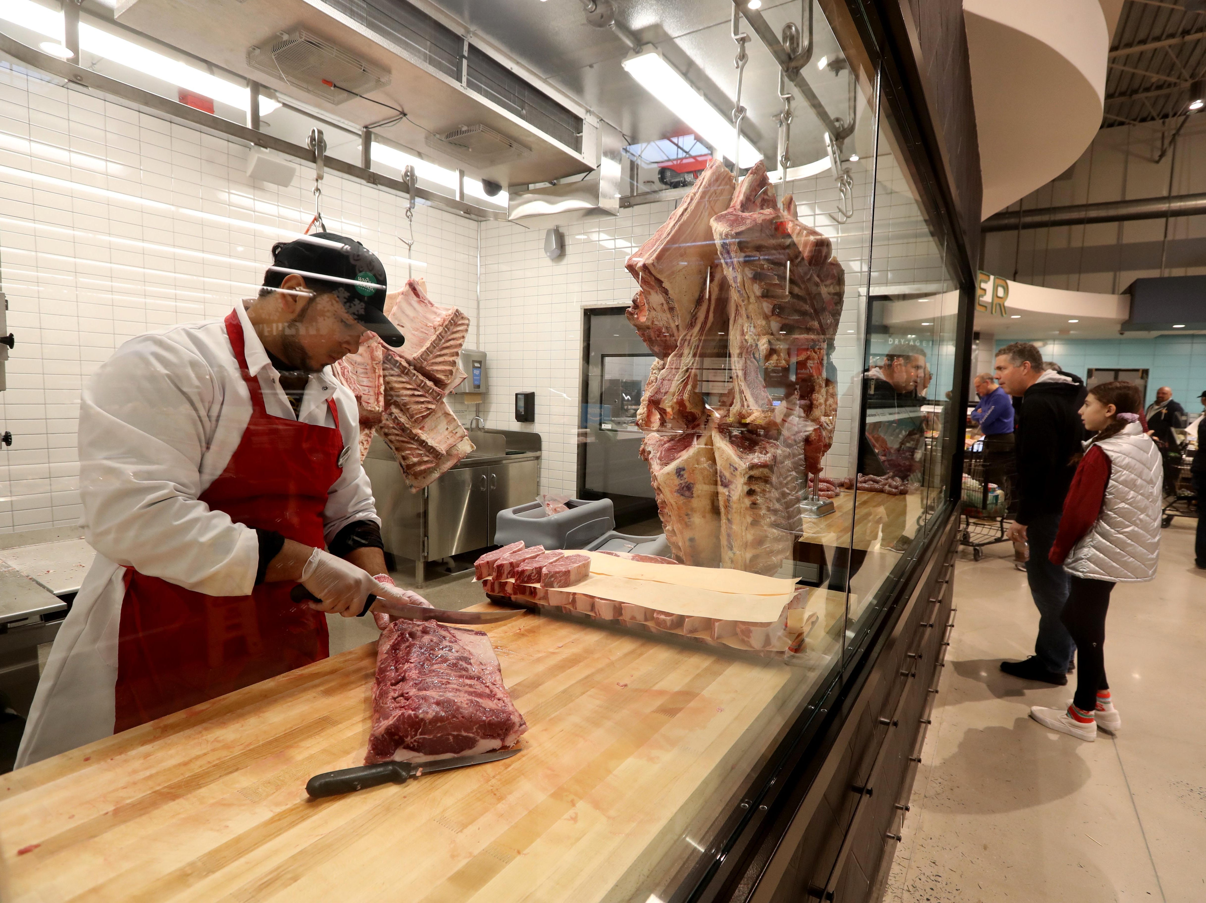A butcher cuts beef into steaks at the new Whole Foods in Chappaqua Dec. 15, 2018. The 40,000 square foot store opened to shoppers on the site of the formers Readers Digest headquarters. The New Castle Town Board and Planning Board approved a temporary traffic plan for the Route 117-Roaring Brook Road intersection that allowed the store to open.