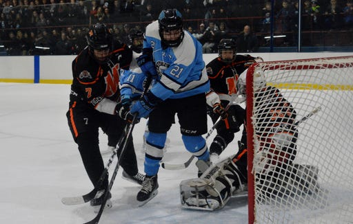 Suffern forward Kyle Foresta (21) looks to see whether his shot had slipped past Mamaroneck goalie Jack Fried, who made 29 saves in a 2-0 win by the Mounties on Friday, December 14, 2018 at Sport-O-Rama.